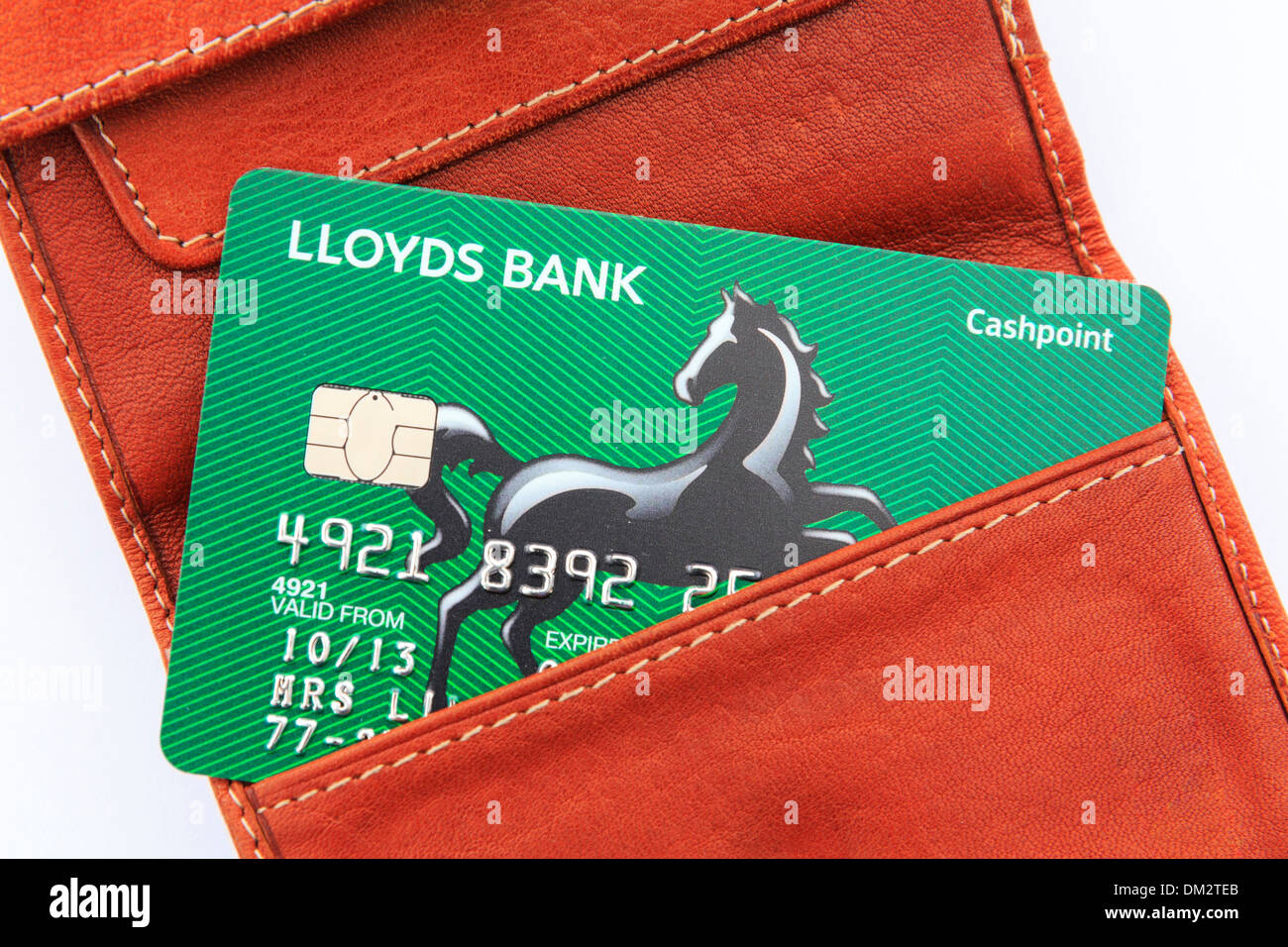 Cut bank card stock photos cut bank card stock images alamy new lloyds bank cashpoint card in a brown leather wallet on a white background england colourmoves