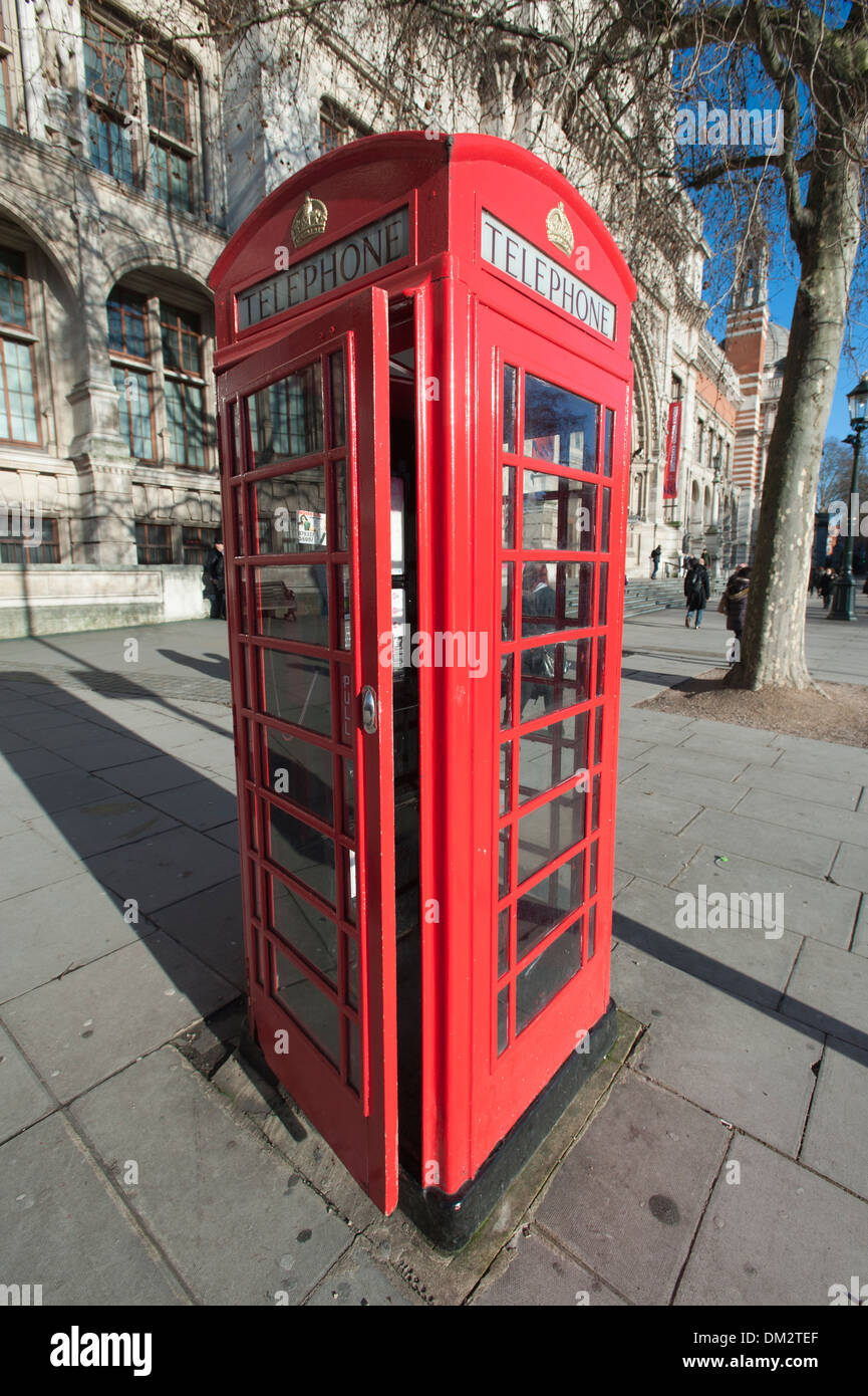 Iconic model K6 red telephone box, designed by Sir Giles Gilbert Scott, South Kensington, London, England, UK - Stock Image