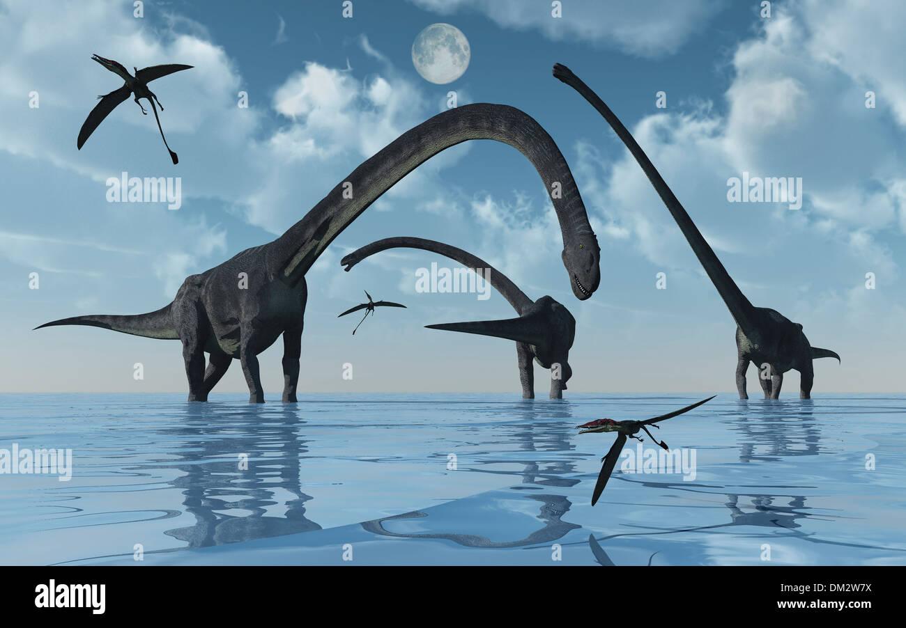 A Group Of Sauropod Omeisaurus Feeding. Stock Photo