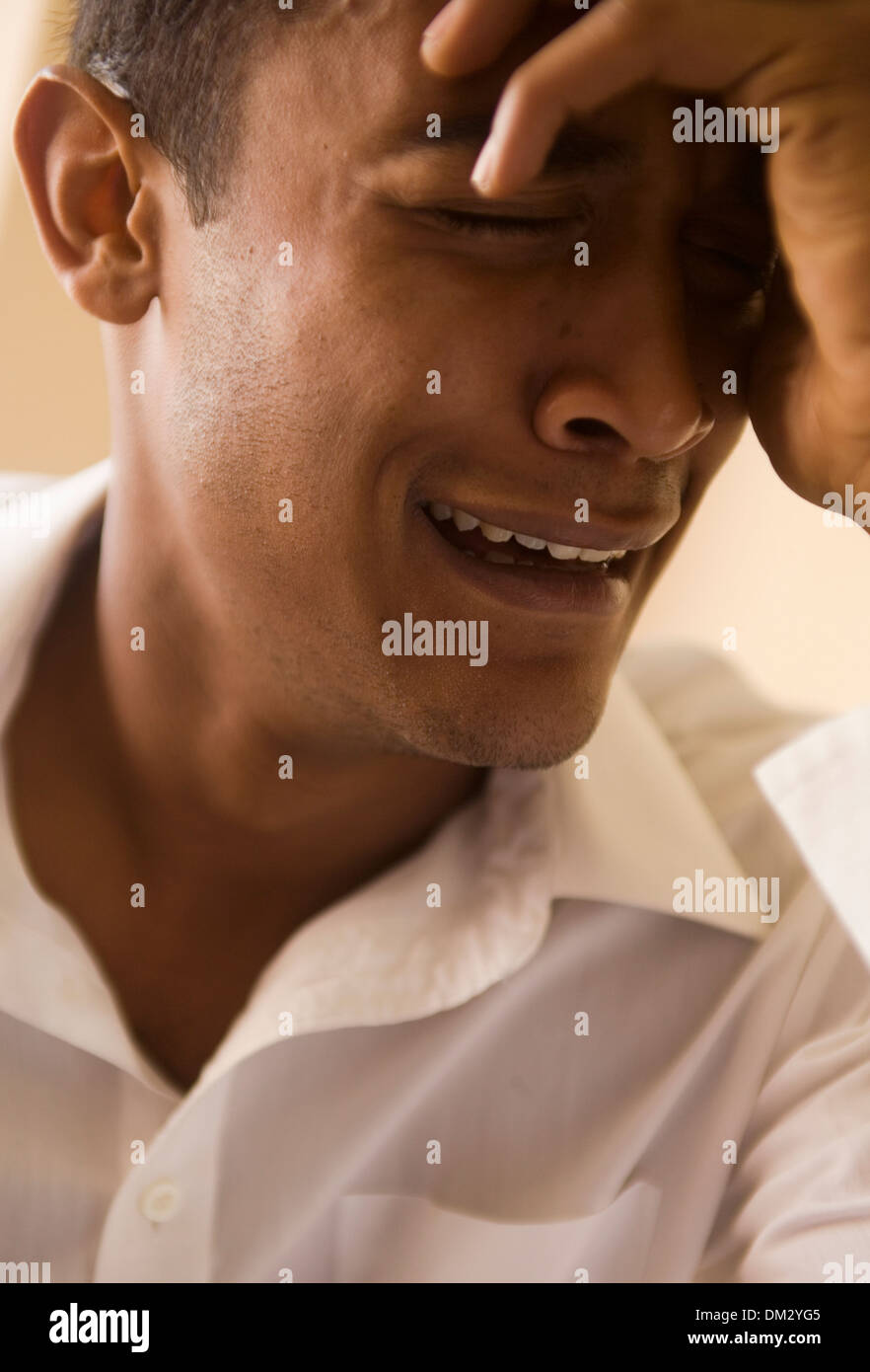AFRICAN AMERICAN MAN CRYING SAD TEARFUL - Stock Image