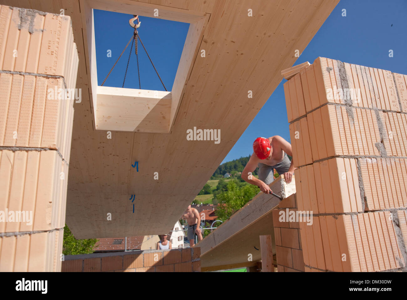 Switzerland Europe timber-frame construction wooden building roof work job occupation profession occupations professions canton - Stock Image
