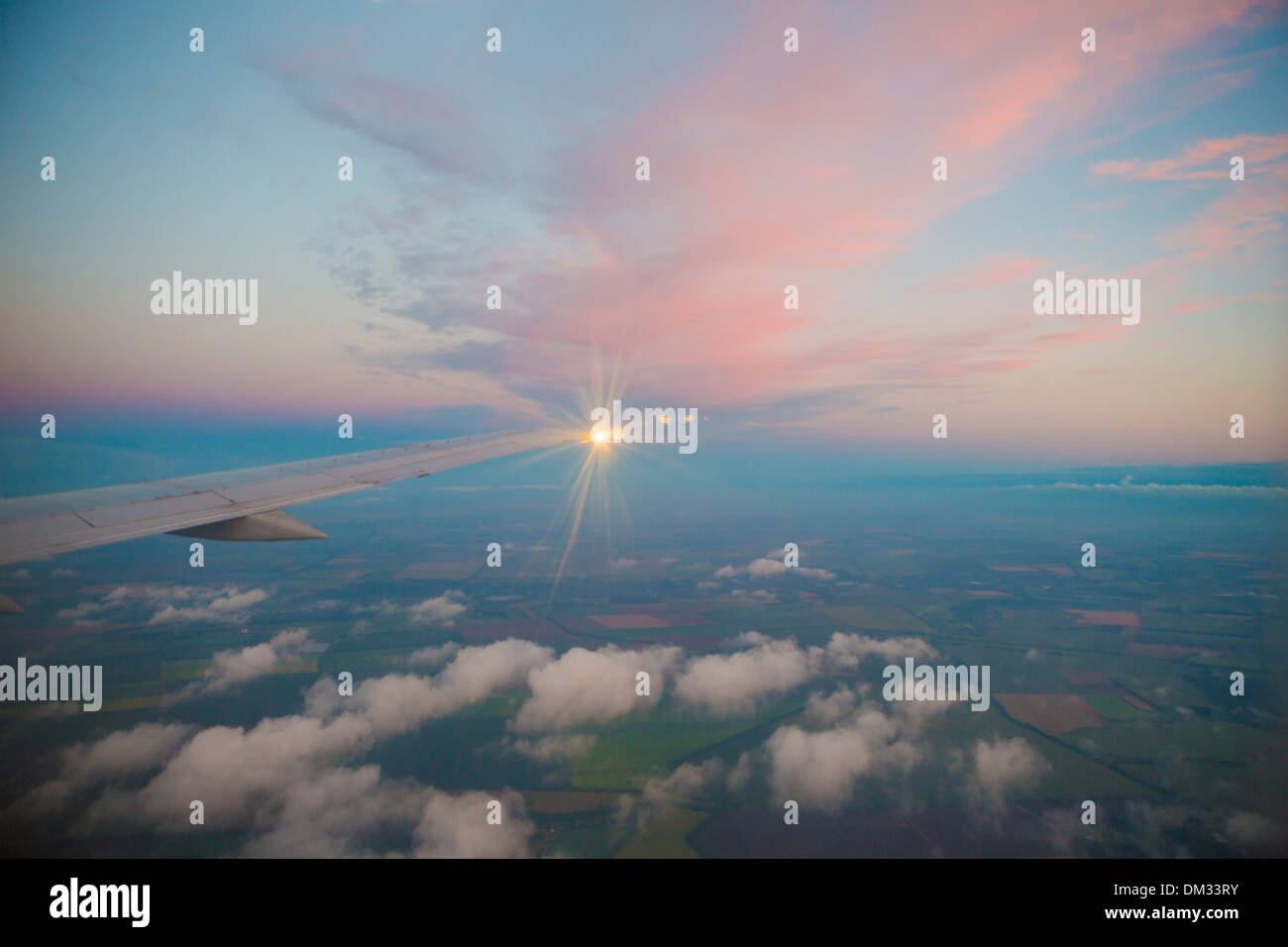 airplane, cloud, clouds, flight, light, sunset, travel, trip, holiday, fly, wing - Stock Image