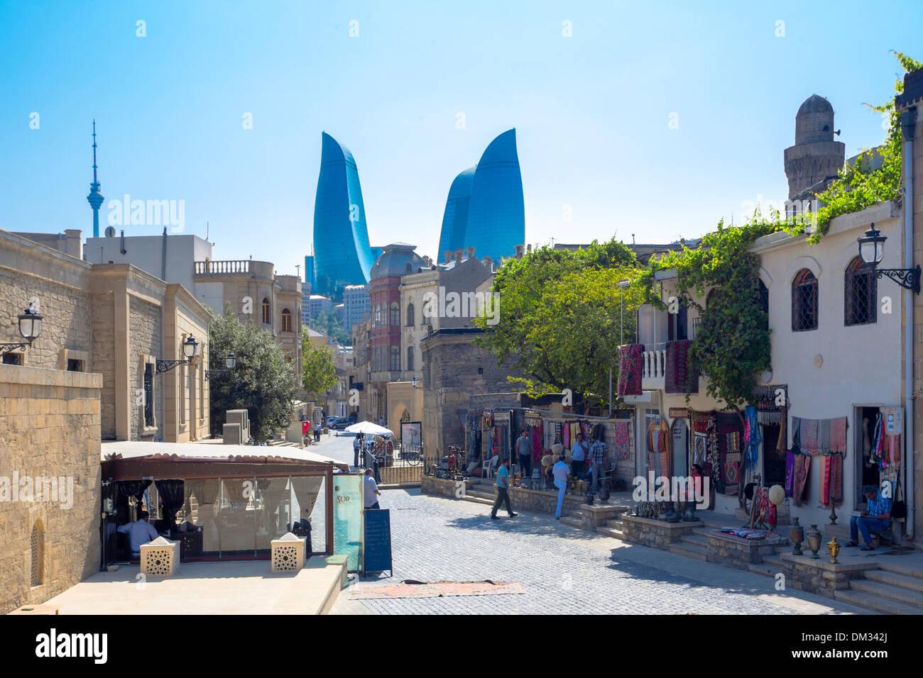 world heritage Azerbaijan Caucasus Eurasia Baku City Flame Old Baku architecture shops skyline street tourists towers travel - Stock Image