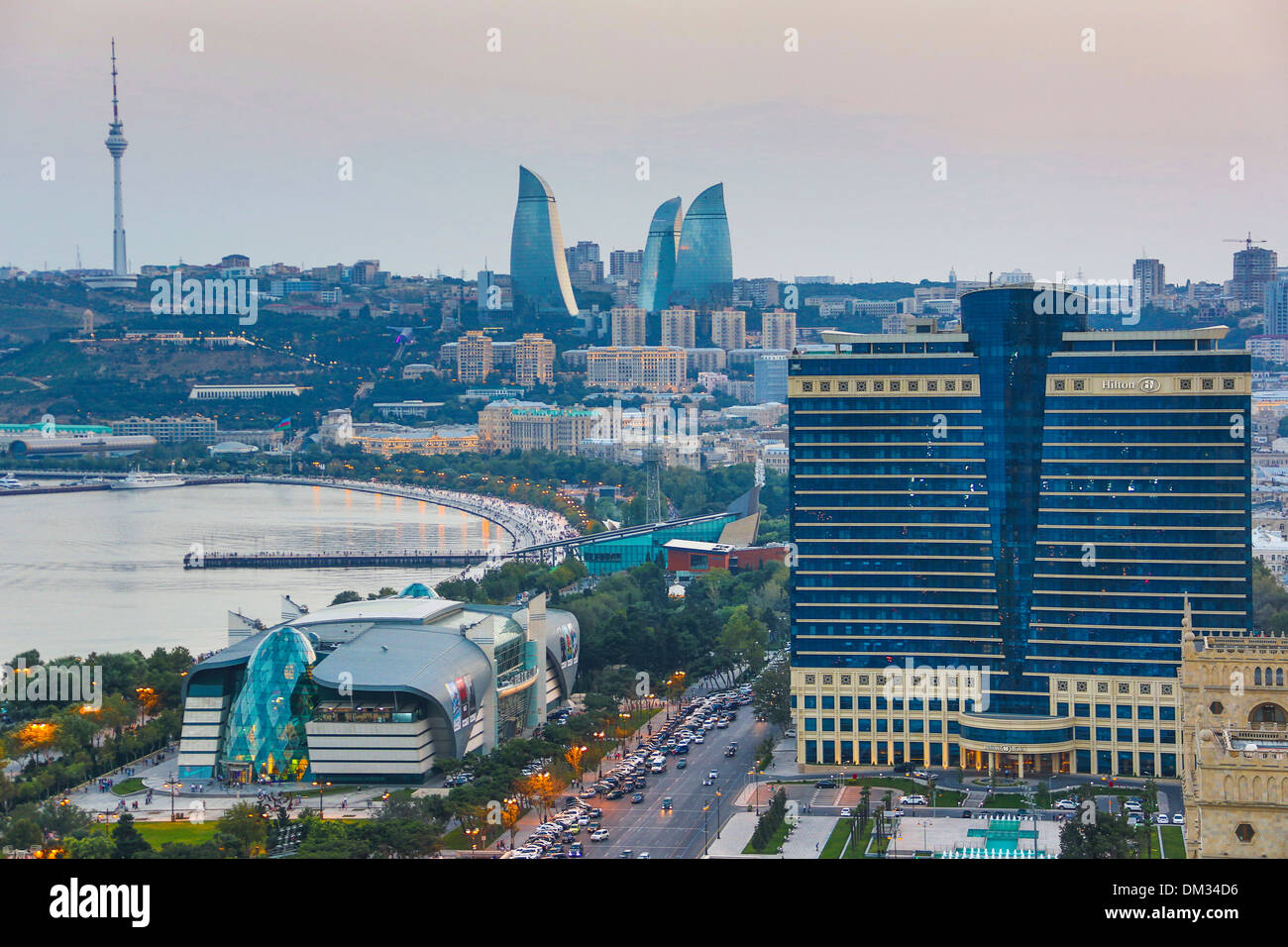 Azerbaijan Caucasus Eurasia Baku Flame Tele architecture avenue bay cars city downtown Hilton skyline sunset touristic Stock Photo