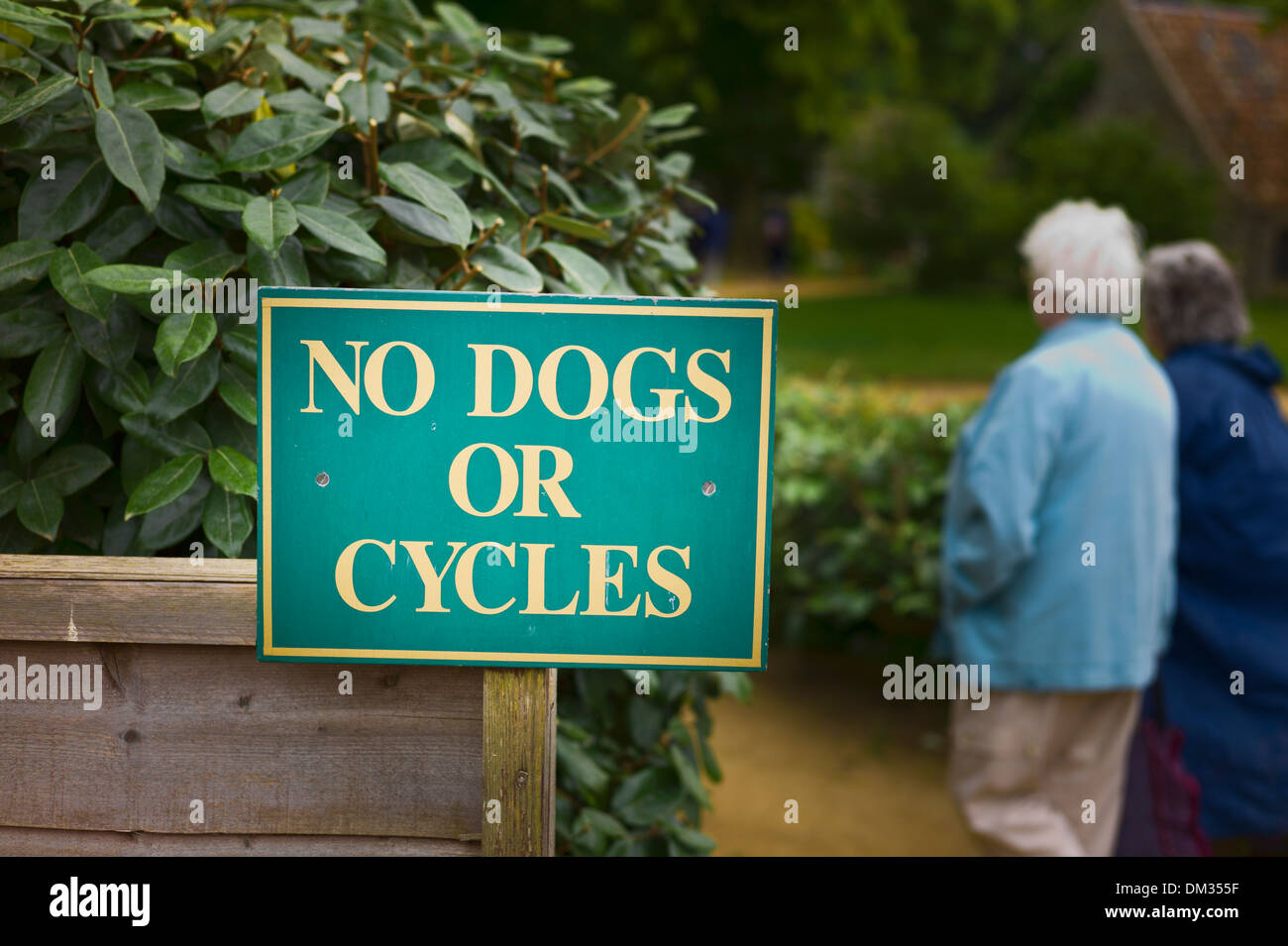 Sign in Sark garden informing limitations of public access to ornamental gardens - Stock Image