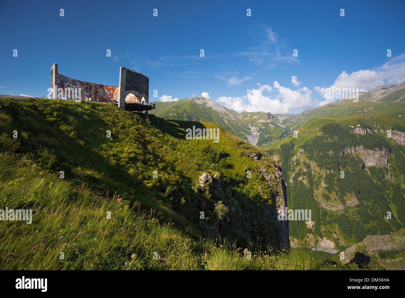 Gudauri Russian Caucasus colourful friendship Georgia Caucasus Eurasia lookout monument mountains pass range top touristic - Stock Image