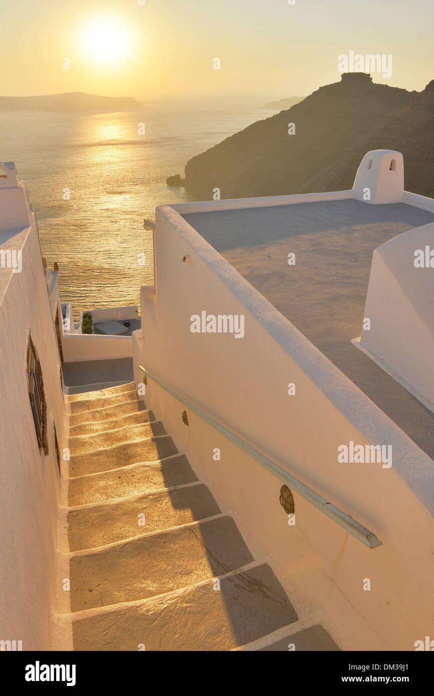 Europe Aegean Cyclades Greece Santorini Thira Island Greek Thira stair steps sunset sun sea travel destination icon resort hotel - Stock Image