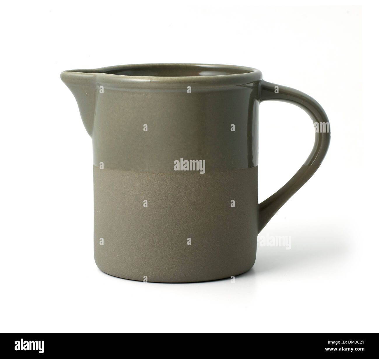 Grey earthenware jug, cut out on white background - Stock Image