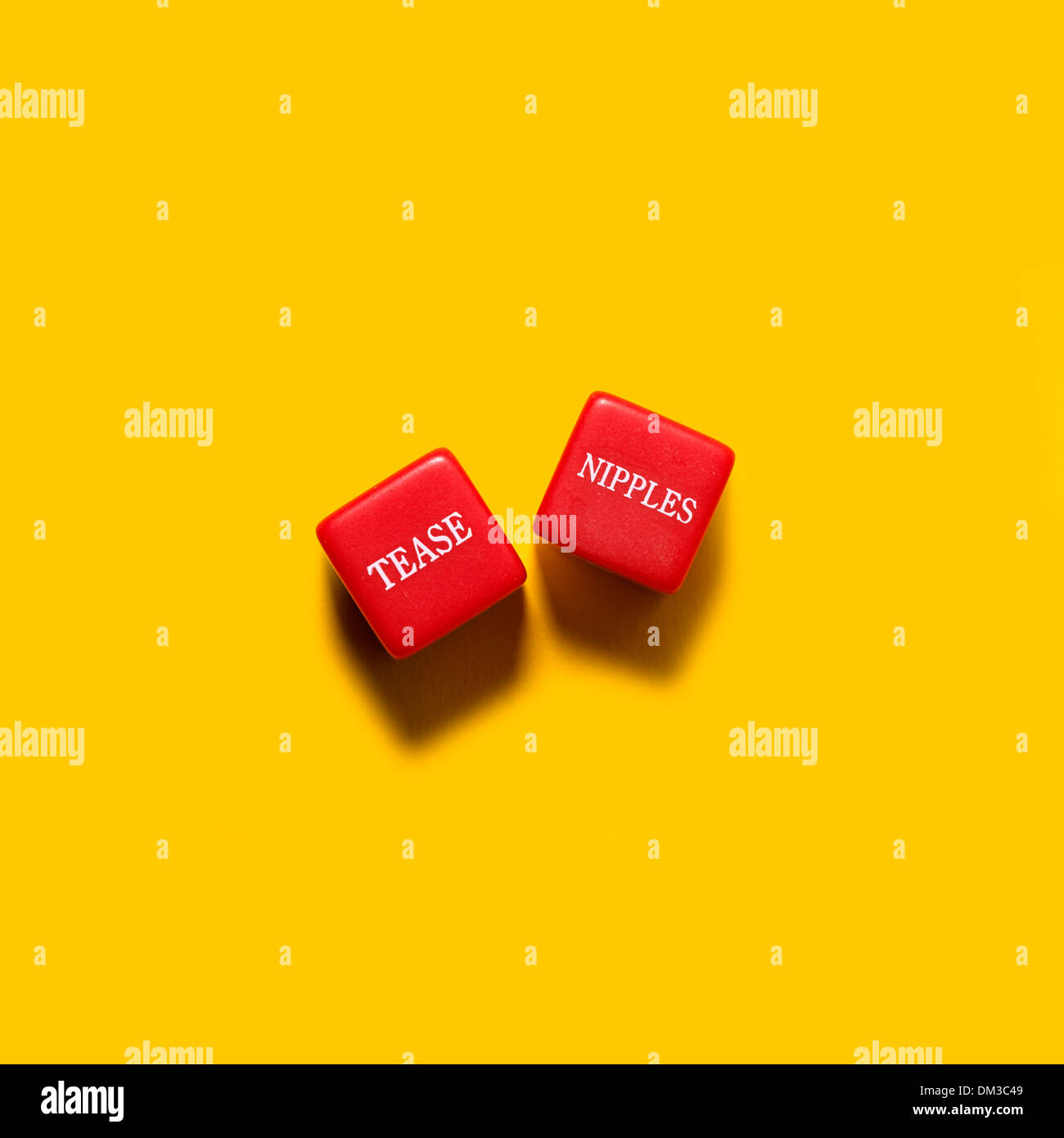 Red fun naughty dice game on yellow background Stock Photo