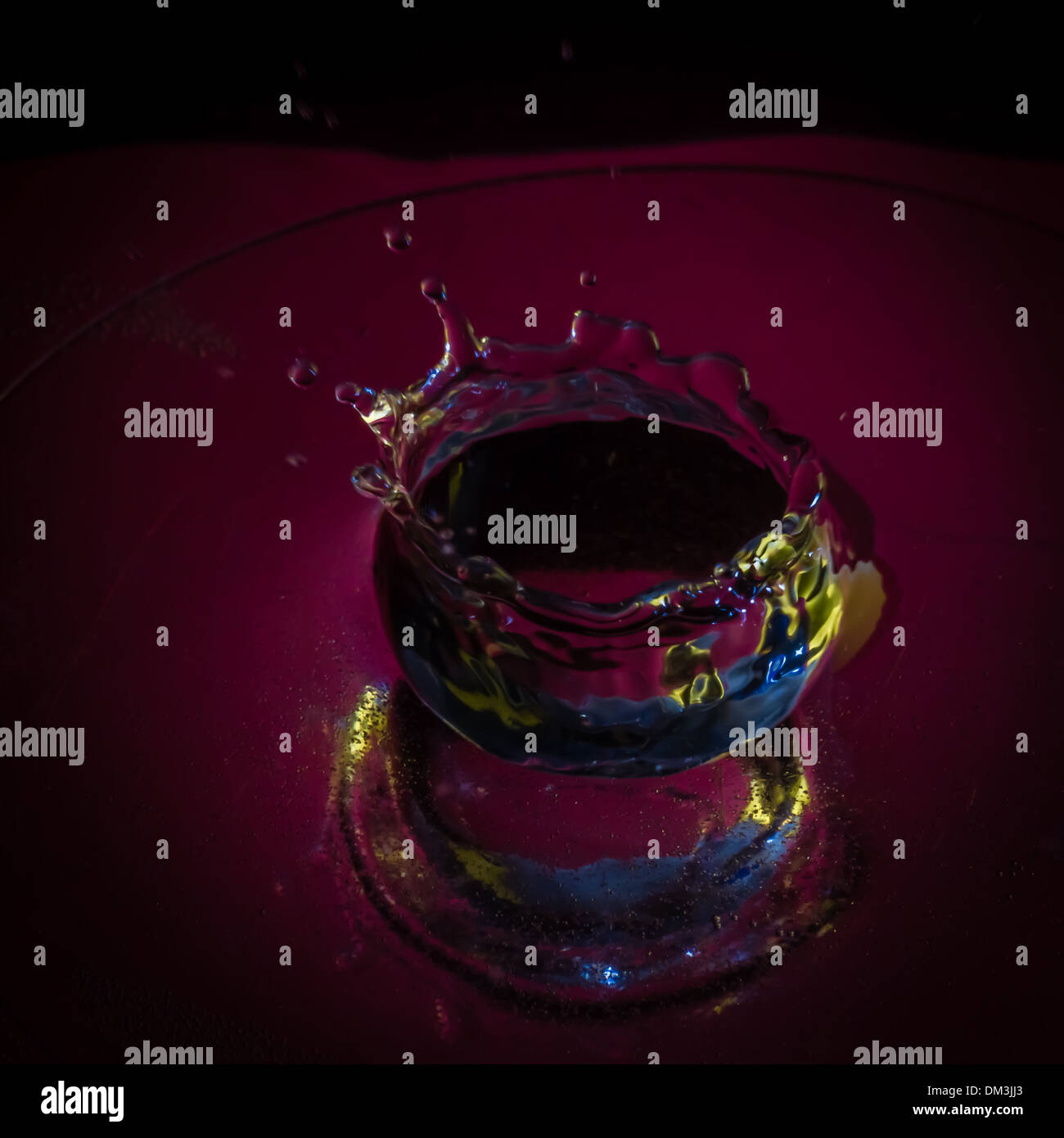 Festive water droplet splash in the shape of a crown - Stock Image