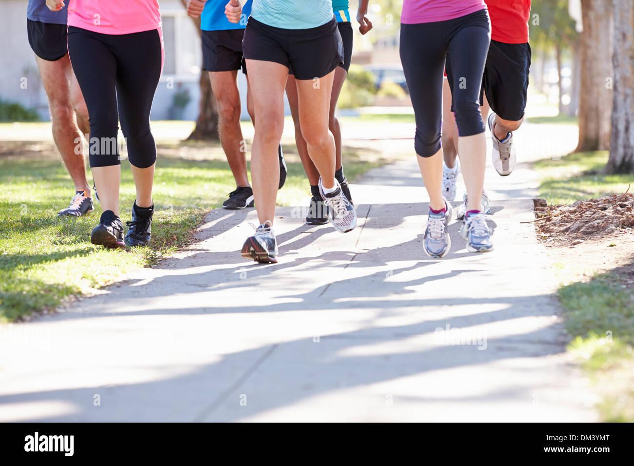 Close Up Of Runners Feet On Suburban Street Stock Photo