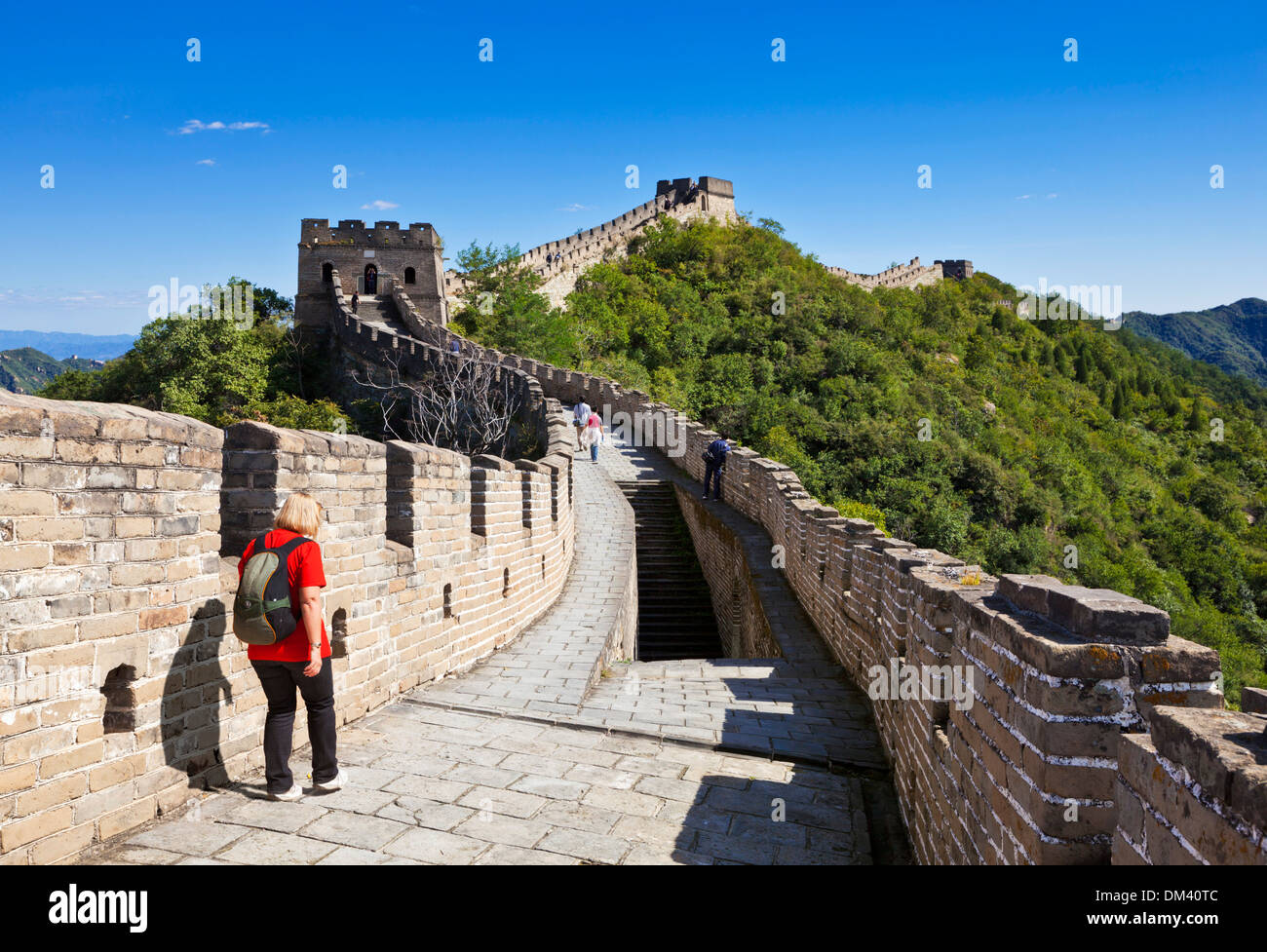 Woman Tourist walking on the Great Wall of China, UNESCO World Heritage Site, Mutianyu, Beijing District, China, - Stock Image