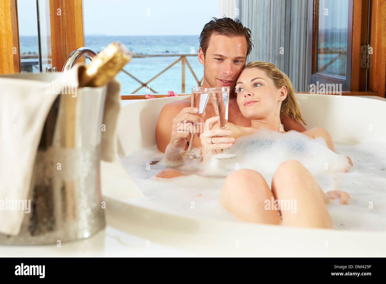 Couple Relaxing In Bath Drinking Champagne Together Stock Photo Alamy