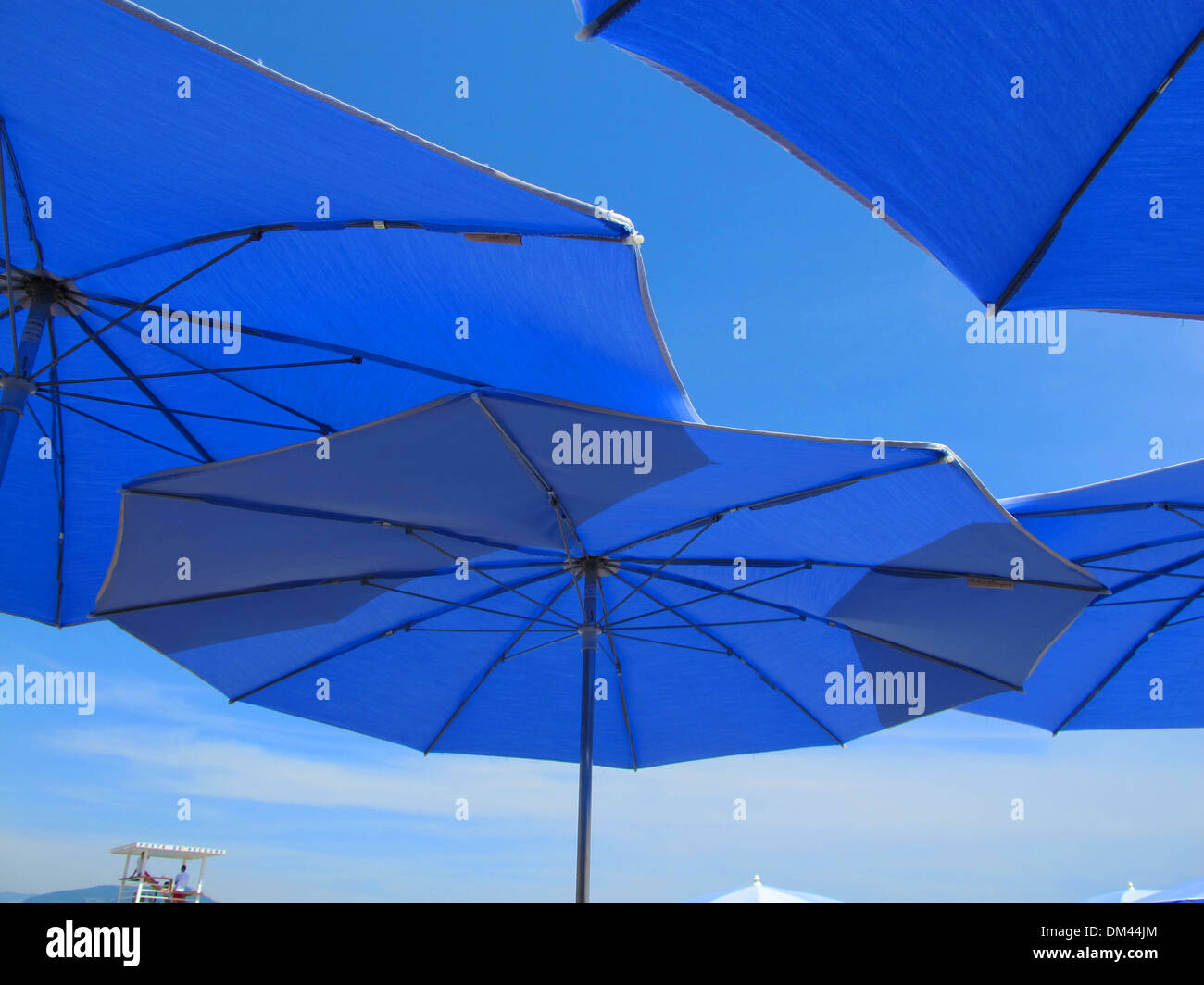 Provencal blue umbrellas in Nice, France - Stock Image