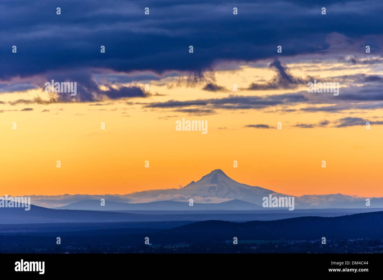 Orange sky over Mt. Hood seen during sunset from Bend, Oregon - Stock Image