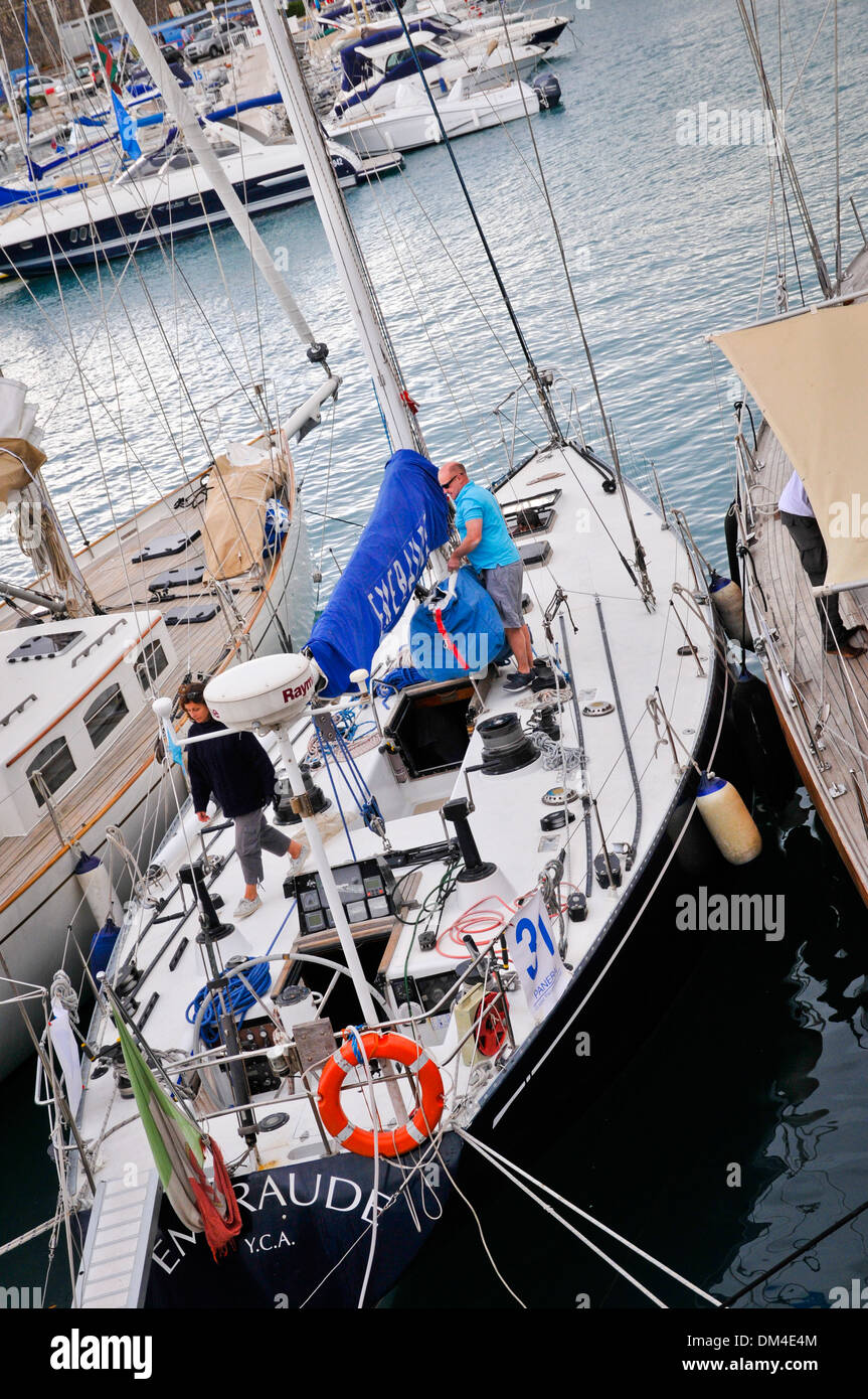 Participants prepare the yacht for competitions, Antibes, southeastern France - Stock Image