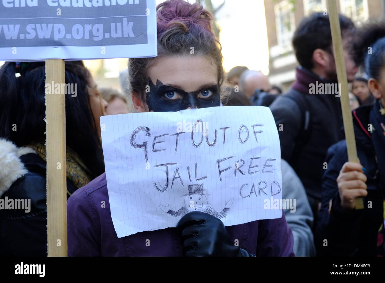 London, UK. 11th December 2013. Students in London protest at cuts and previous police violence. Starting with a - Stock Image