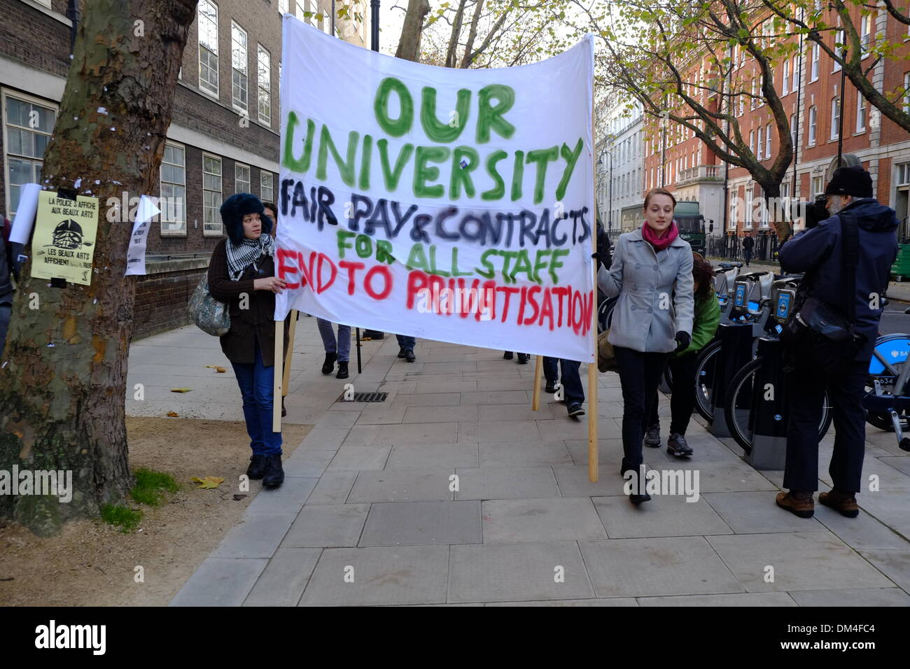London, UK. 11th December 2013. Students in London protest at cuts and previous police violence. Starting with a demo at UCL and SOAS they later march through central London Credit:  Rachel Megawhat/Alamy Live News - Stock Image