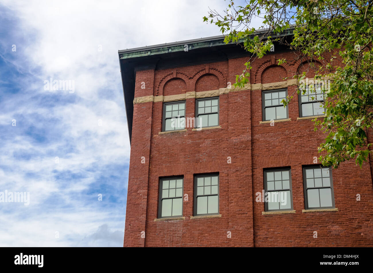 Old red brick building in downtown Portland, Oregon - Stock Image