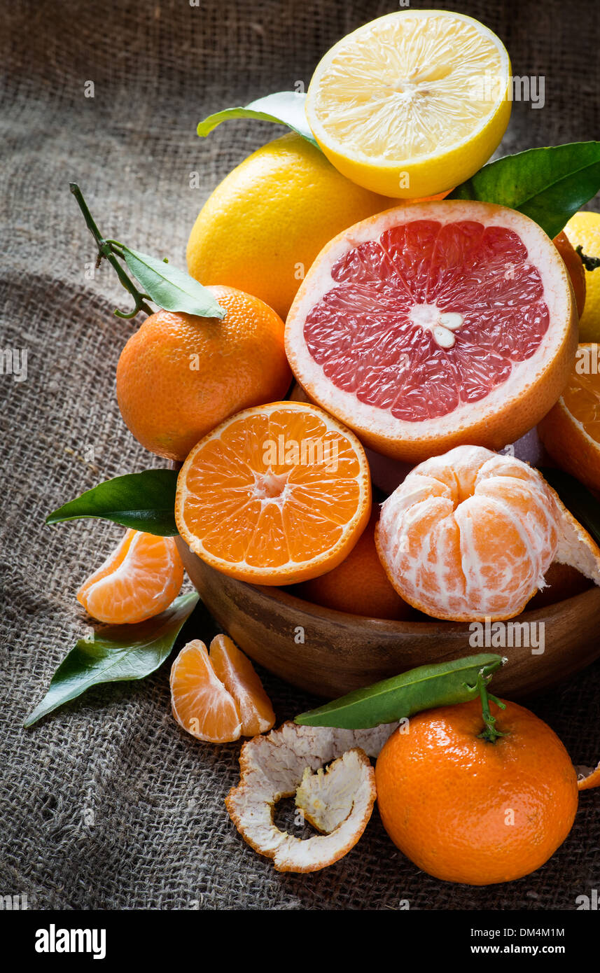 Fresh citrus fruits on rustic background, selective focus - Stock Image