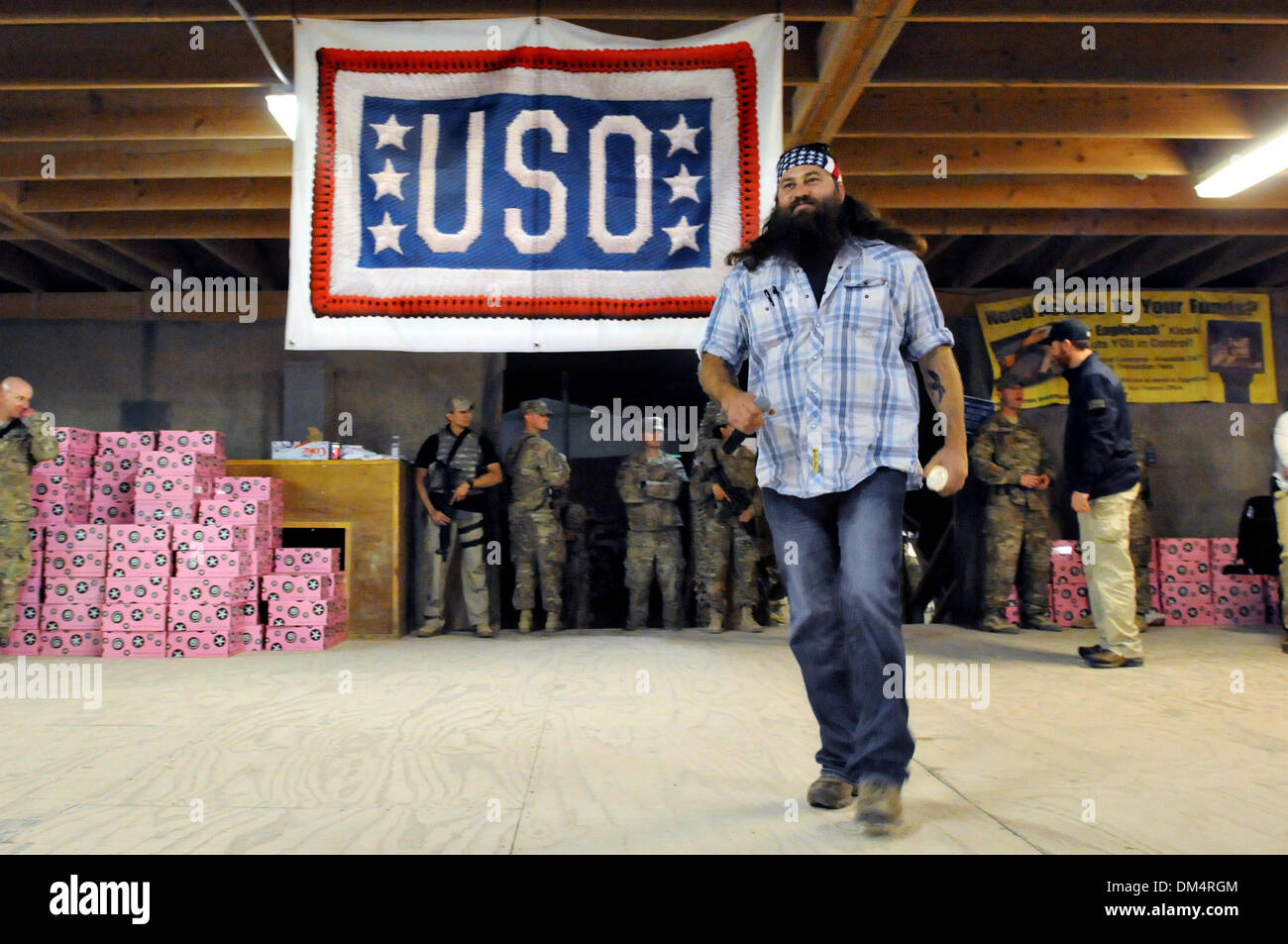 Camp Leatherneck, Helmand, Afghanistan. 10th December 2013. Duck Dynasty reality television star Willie Robertson walks on stage December 10, 2013 at Kandahar Airfield, Kandahar province, Afghanistan. The visit was part of the USO Holiday Tour. Credit:  Planetpix/Alamy Live News - Stock Image