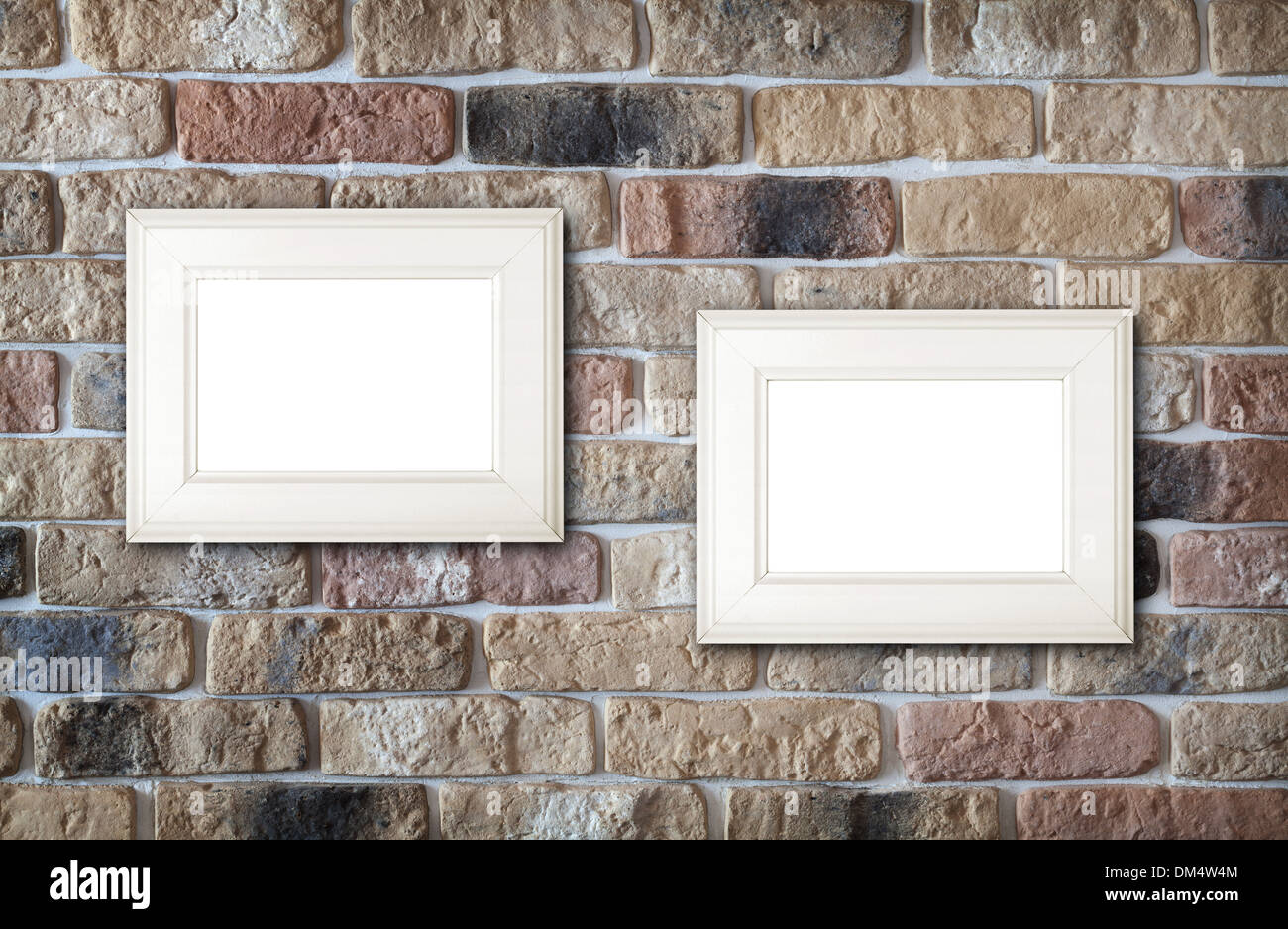Photo frames on brick wall background - Stock Image