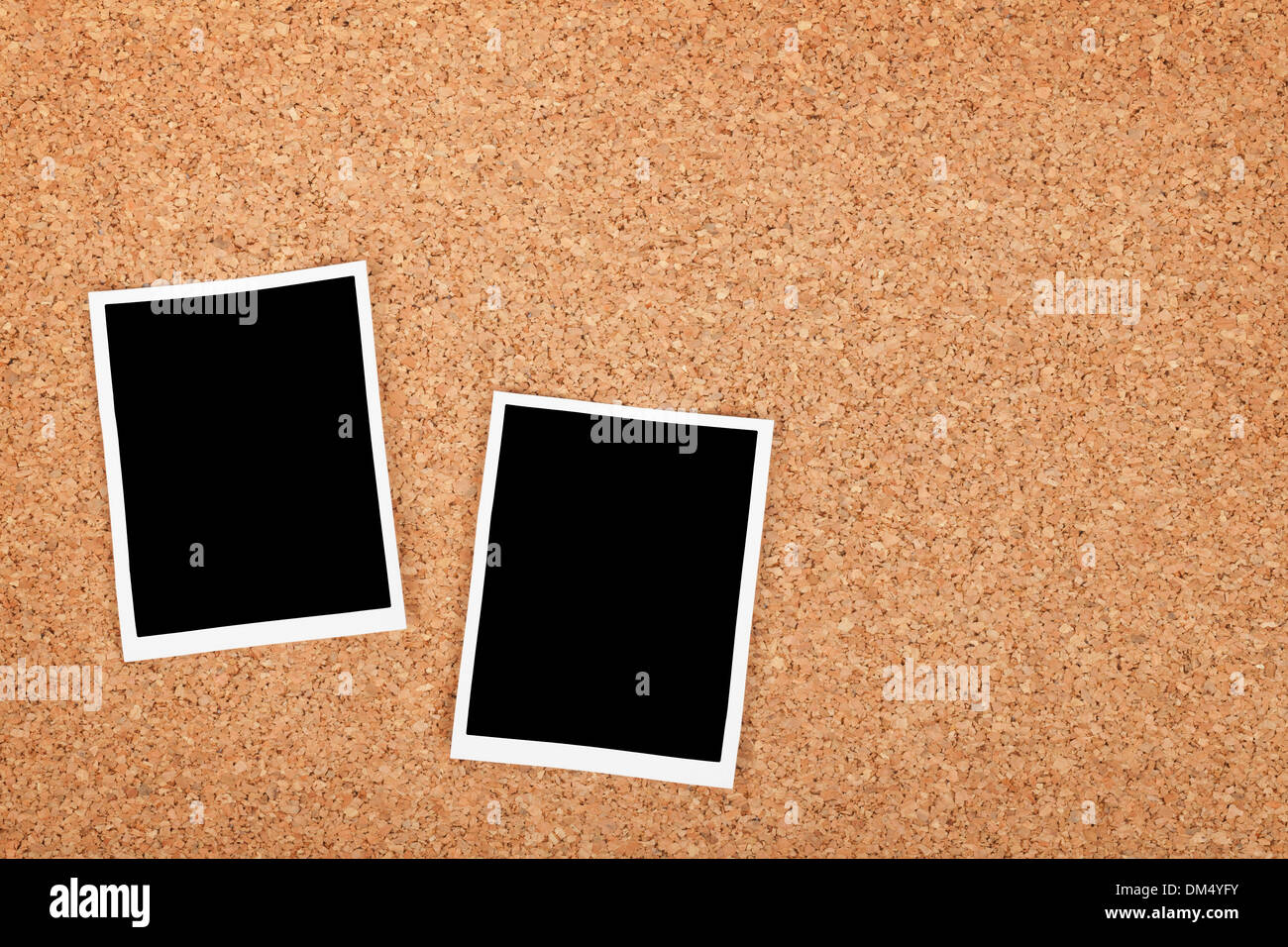 Polaroid photo frames on cork texture background with copyspace - Stock Image