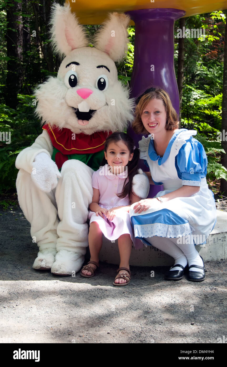 Child with Characters from Alice in Wonderland at Alice aux Pays des Merveilles amusement park Laurentians Quebec - Stock Image