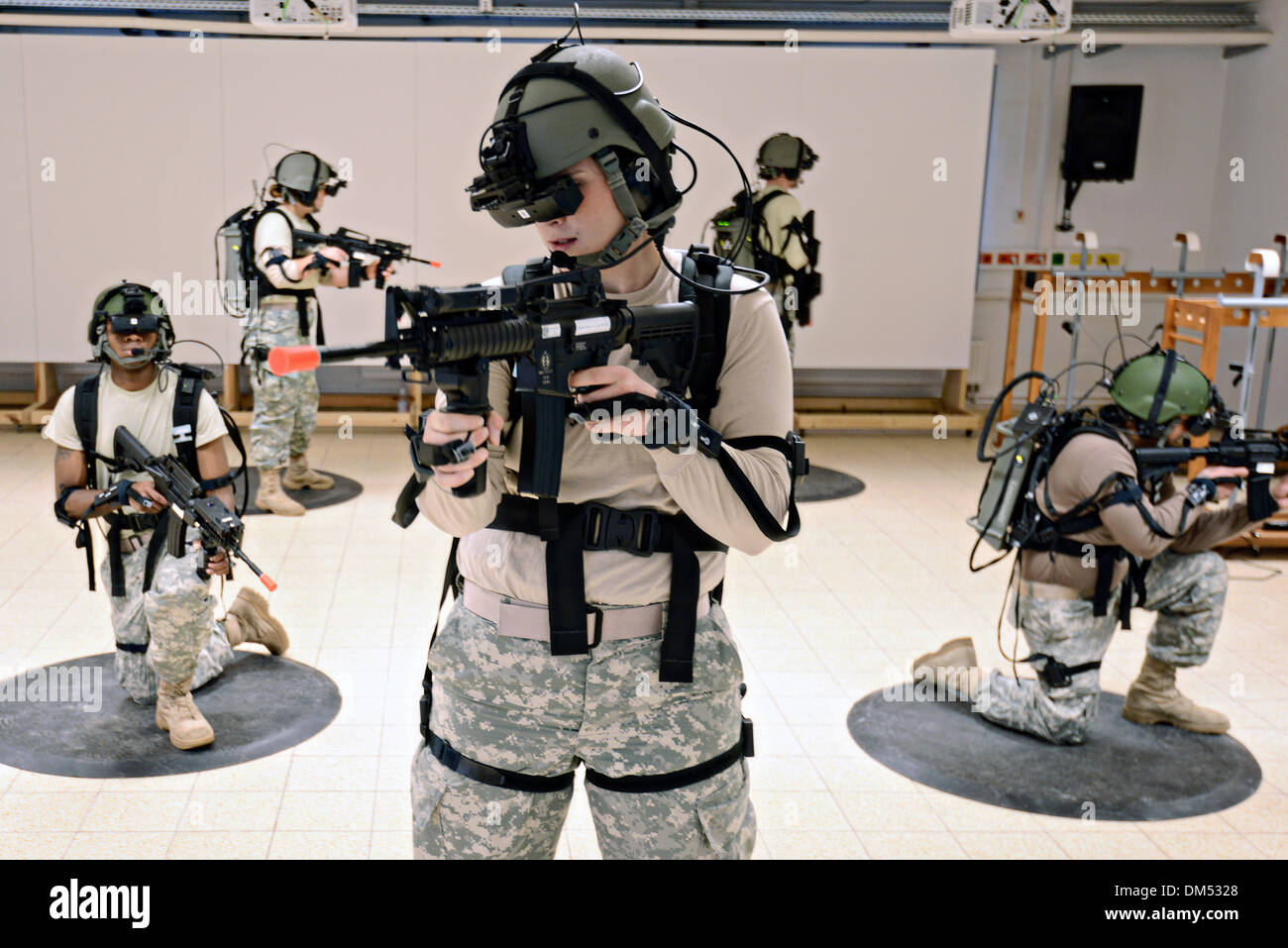 US Army soldiers conduct immersive virtual simulation training using the Dismounted Soldier Training System  December 11, 2013 in Grafenwoehr, Germany. - Stock Image