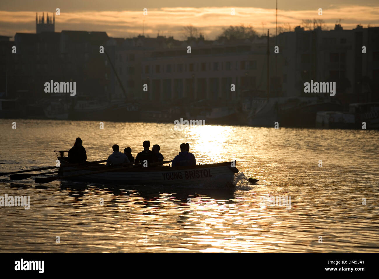 Early morning rowers on the river. - Stock Image