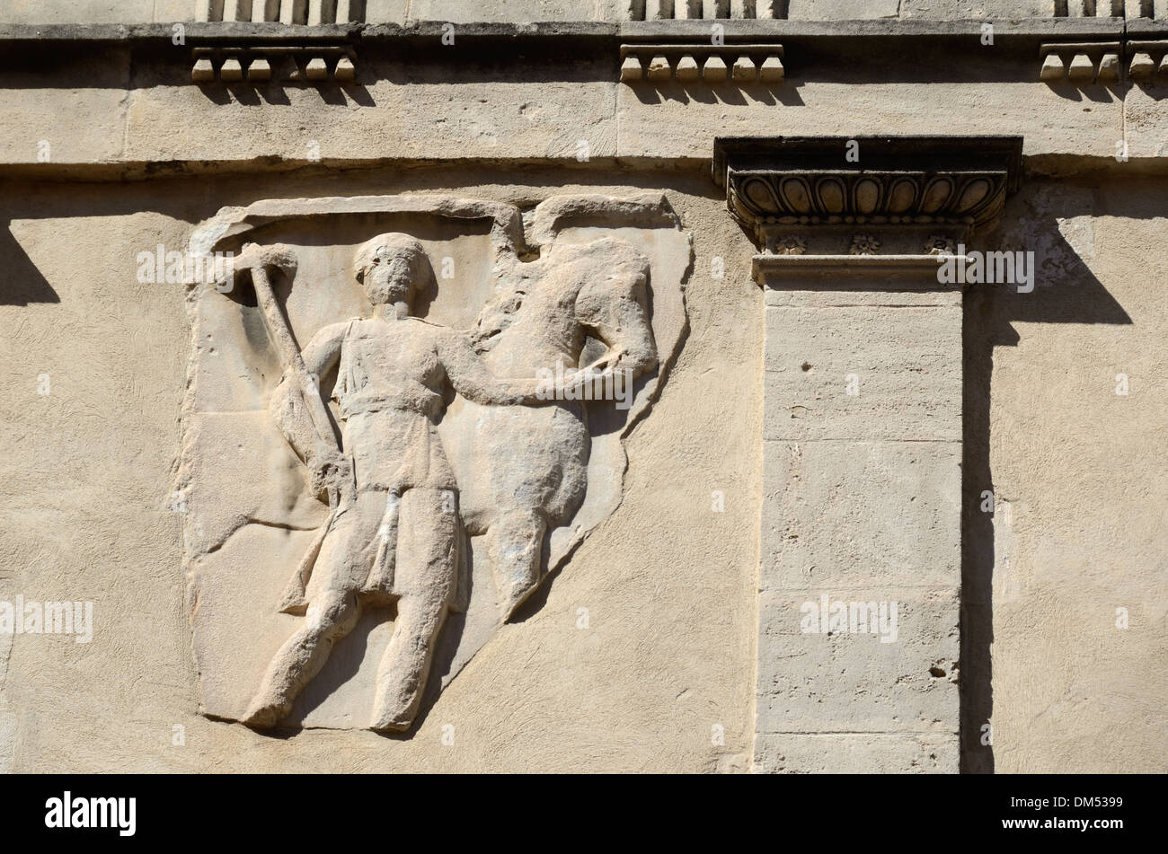 Roman Cavalry Sculpture or Bas-Relief Embedded in Wall of a Town House on Rue des Arenes Arles Provence France - Stock Image