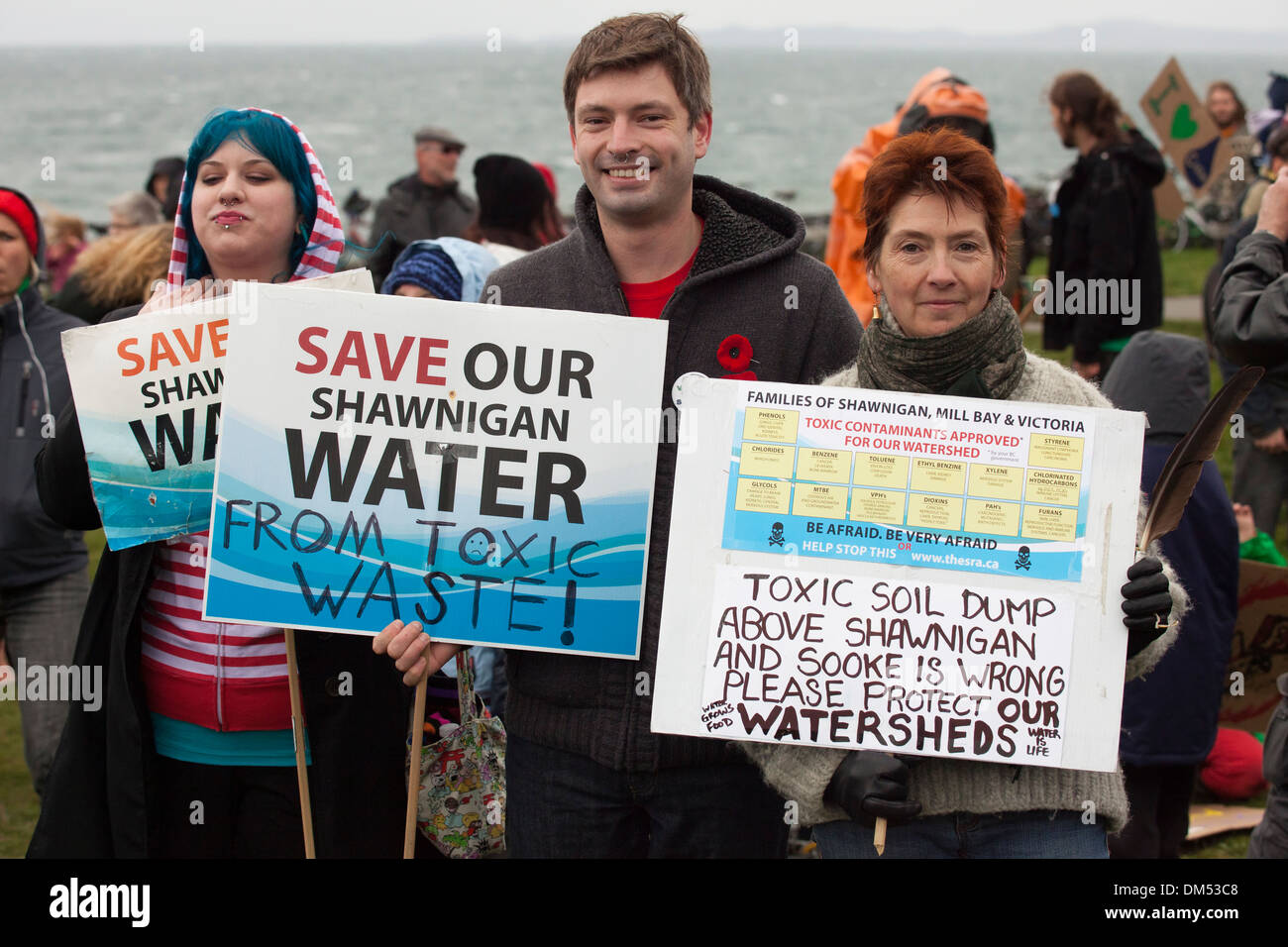 Anti toxic waste dumping signs and demonstrators at rally-Victoria, British Columbia, Canada. - Stock Image