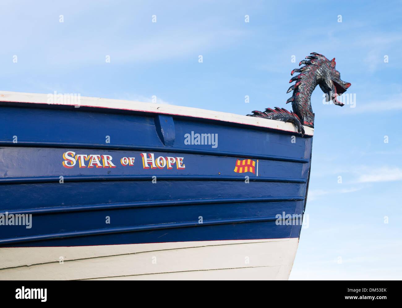 Dragon figurehead on fishing coble Seaton Sluice, north east England UK - Stock Image