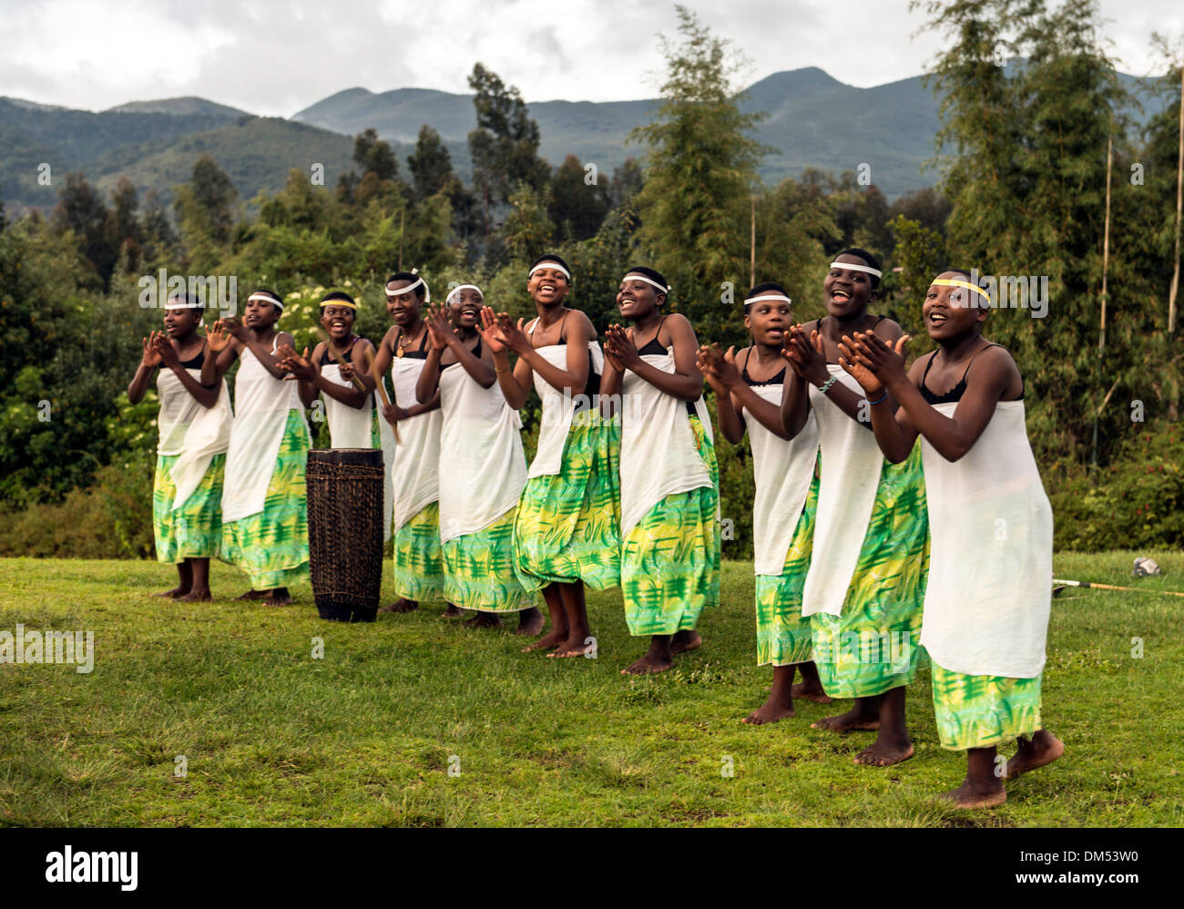 Traditional African dancers singing Volcanoes National Park Rwanda Africa - Stock Image