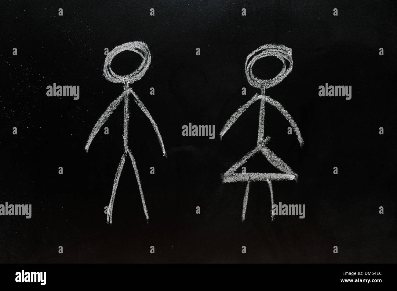 Man and woman stick people drawn on a blackboard in chalk. Stock Photo