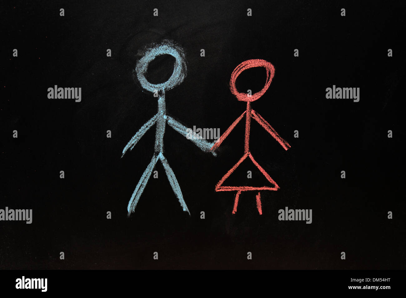 A man and a woman drawn on a blackboard in chalk. - Stock Image