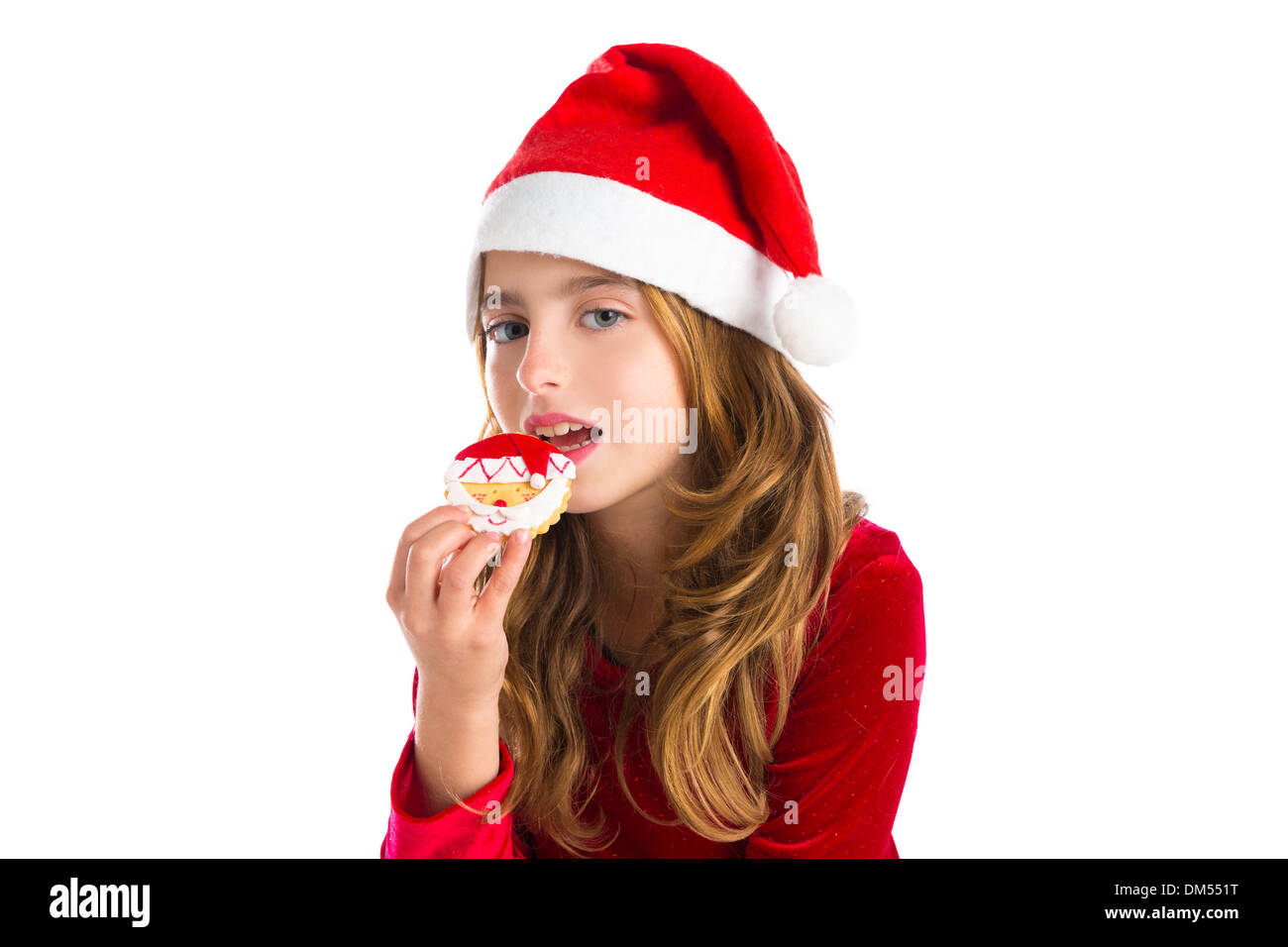 Christmas kid girl eating Xmas Santa cookie isolated on white Stock ...