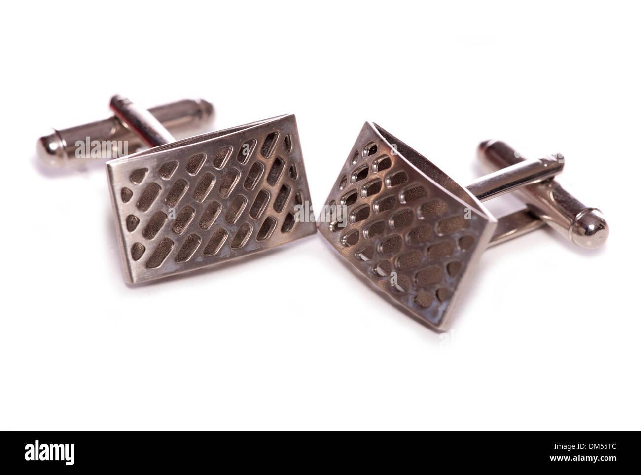 silver cuff links studio cutout - Stock Image