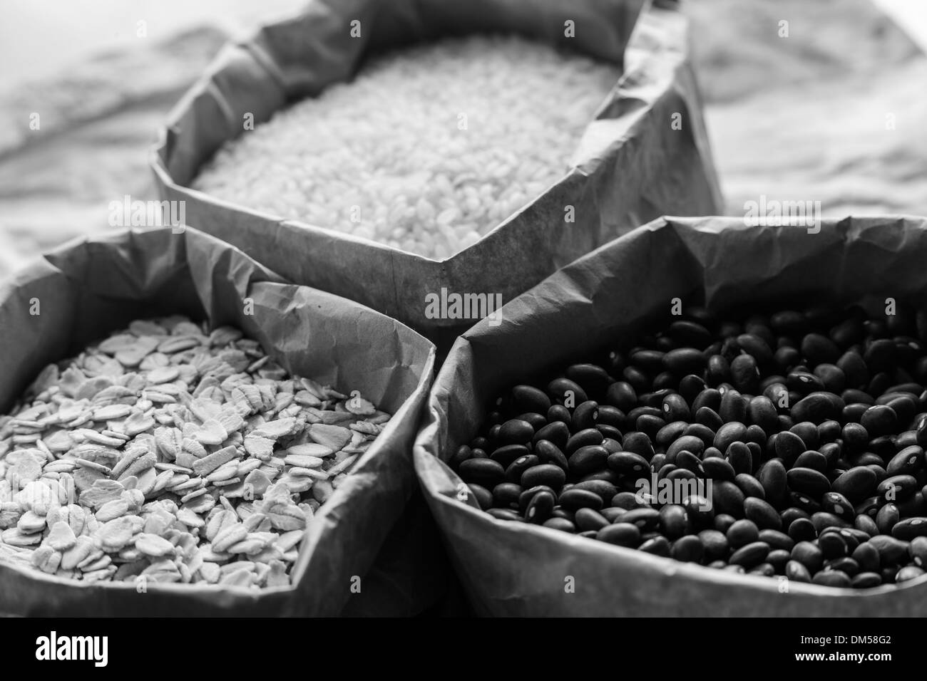 B&W of bags of grains. - Stock Image