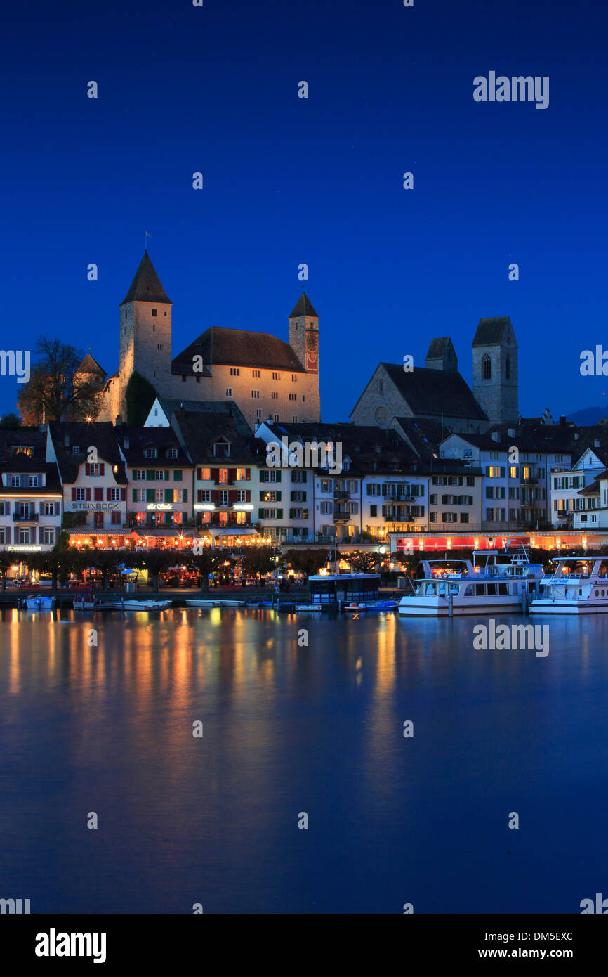 Evening blue hour lesson dusk twilight church light night Rapperswil Reflection castle castle Rapperswil Switzerland Europe - Stock Image