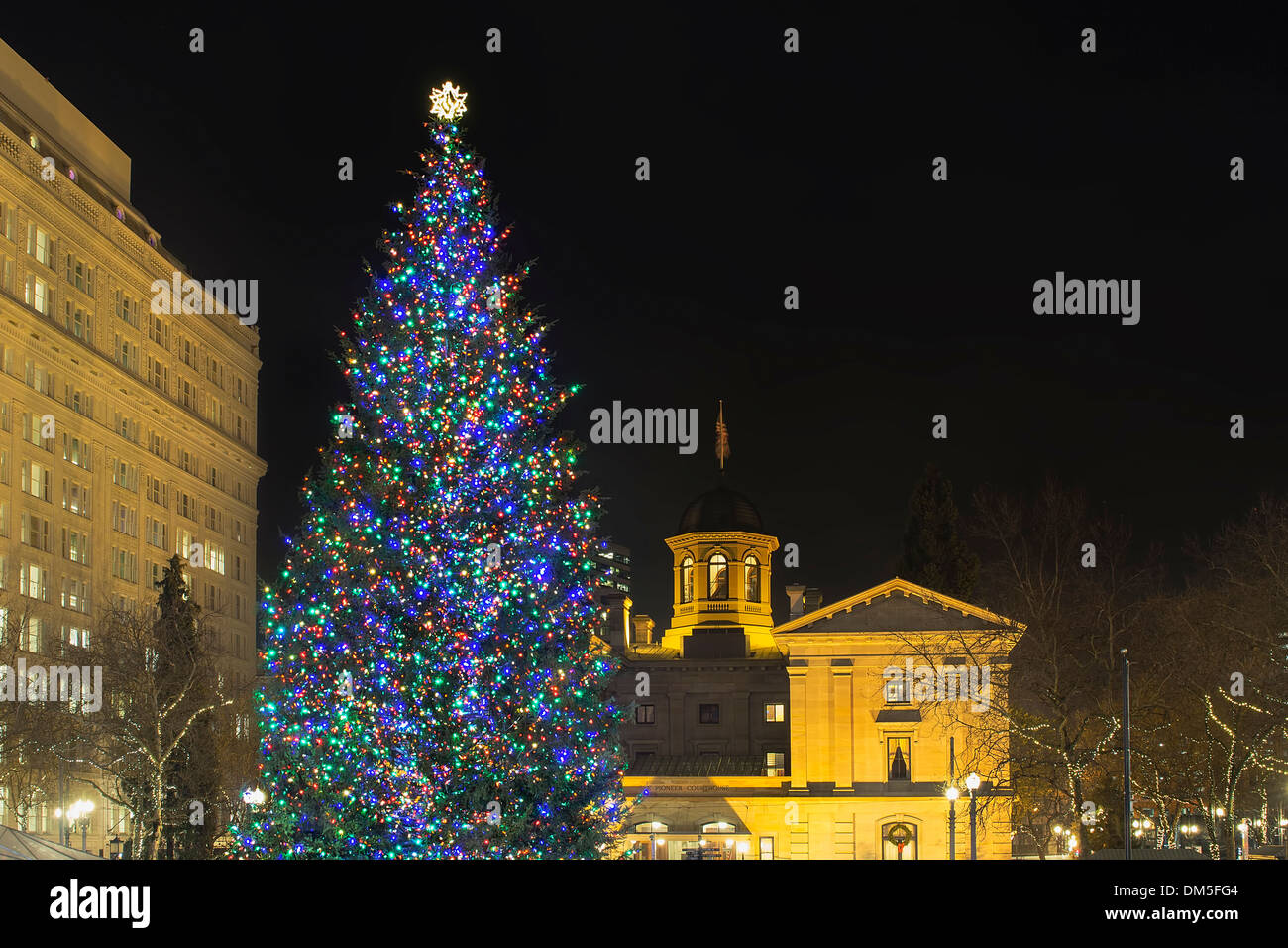 Christmas Holiday Tree at Pioneer Courthouse Square in Portland Oregon Downtown Decorated with Colorful Lights at Night Stock Photo