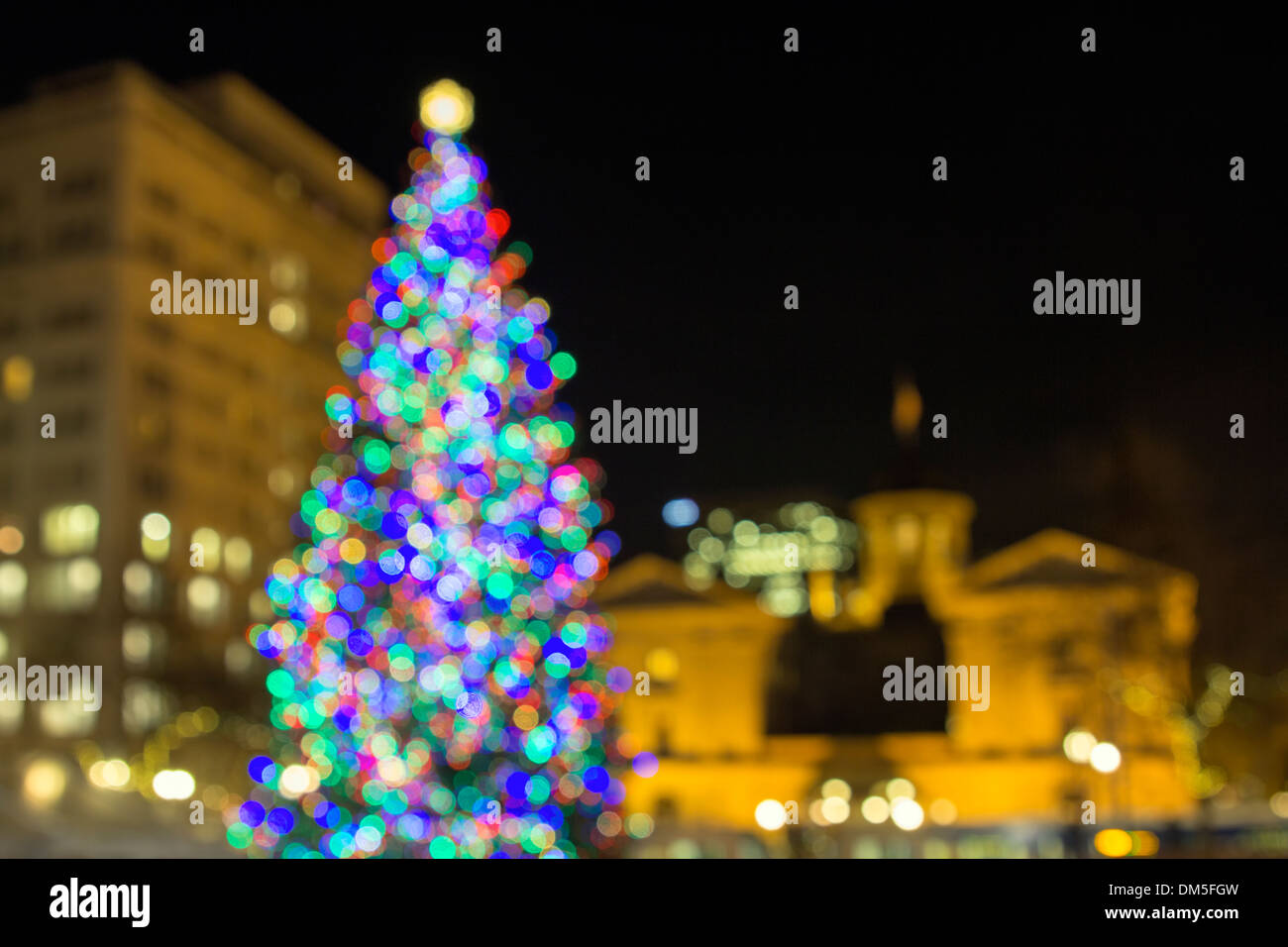 Christmas Holiday Tree with Festive Colorful Out of Focus Bokeh Lights  in Pioneer Courthouse Square Stock Photo