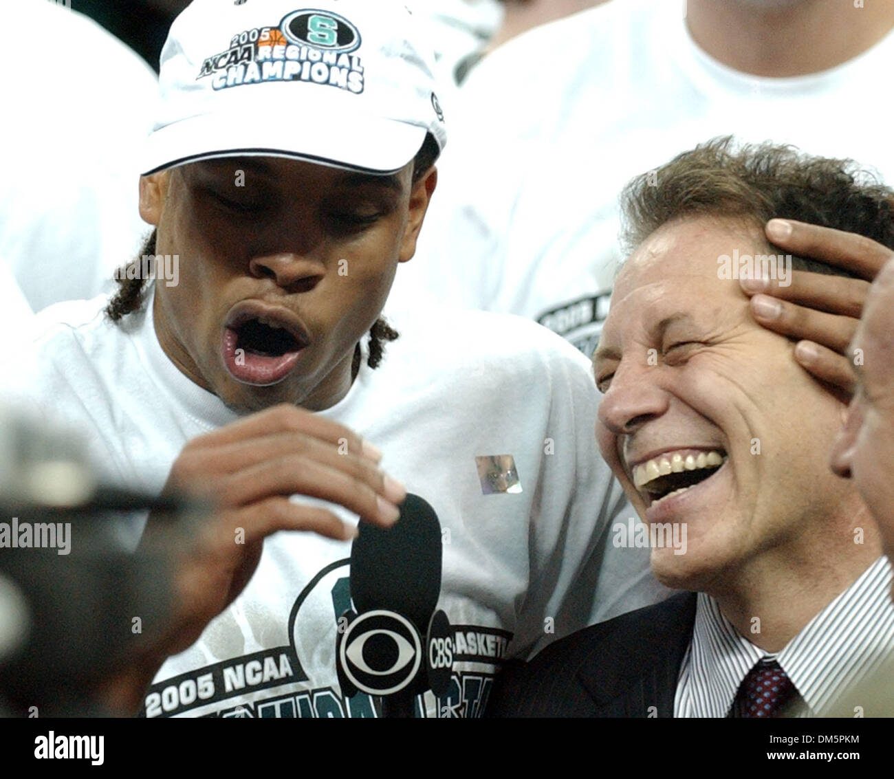 Mar 27, 2005; AUSTIN, TX, USA; Michigan State's Shannon Brown celebrates with headcoach Tom Izzo while being interviewed after defeating Kentucky 94-88 Sunday March 27, 2005 at the Erwin Center in Austin,Tx. - Stock Image