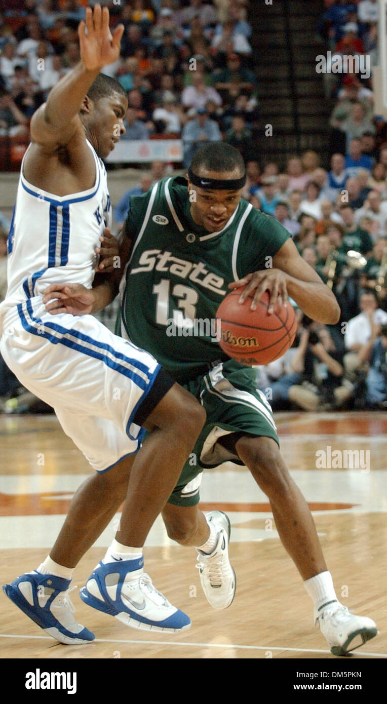 Mar 27, 2005; AUSTIN, TX, USA;  Michigan State's Maurice Ager drives around Kentucky's Kelenna Azubuike in the NCAA Austin Region final at the Frank Erwin Center in Austin, Texas, Sunday, March 27, 2005. - Stock Image