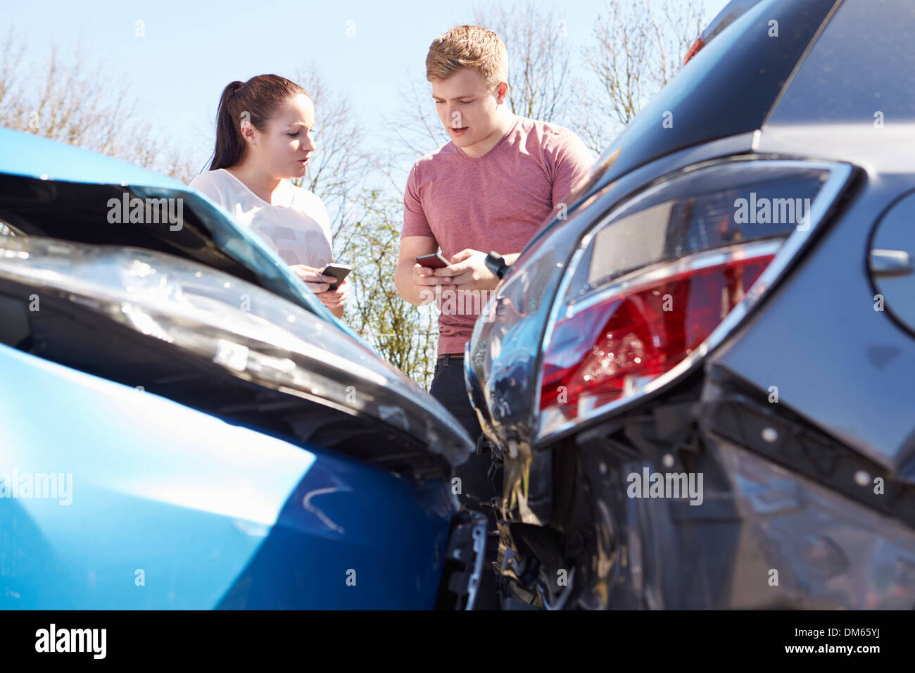 Two Drivers Exchange Insurance Details After Accident - Stock Image