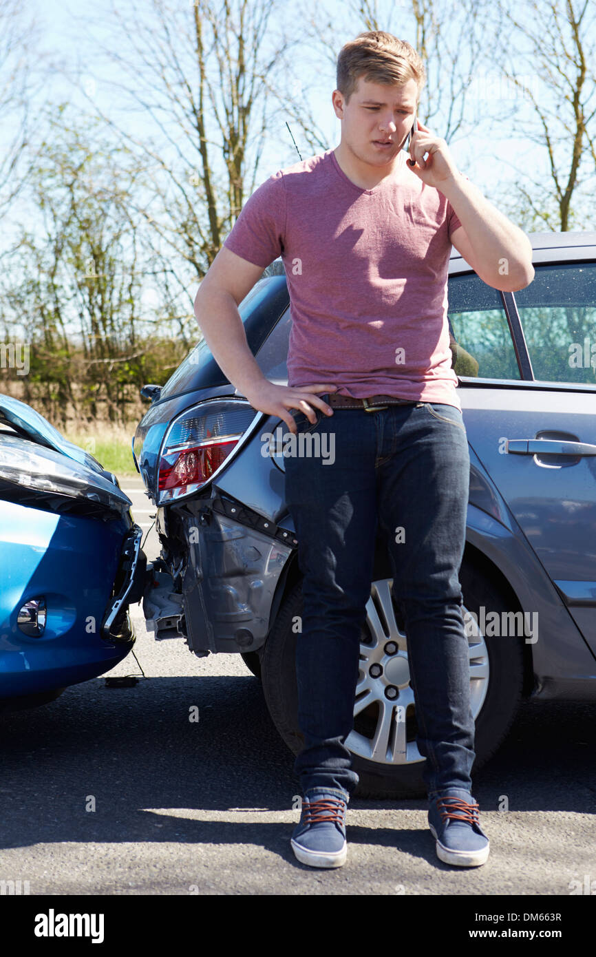 Businessman Making Phone Call After Traffic Accident Stock Photo