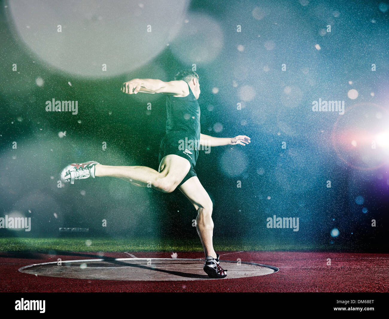 Discus thrower spinning before a throw - Stock Image