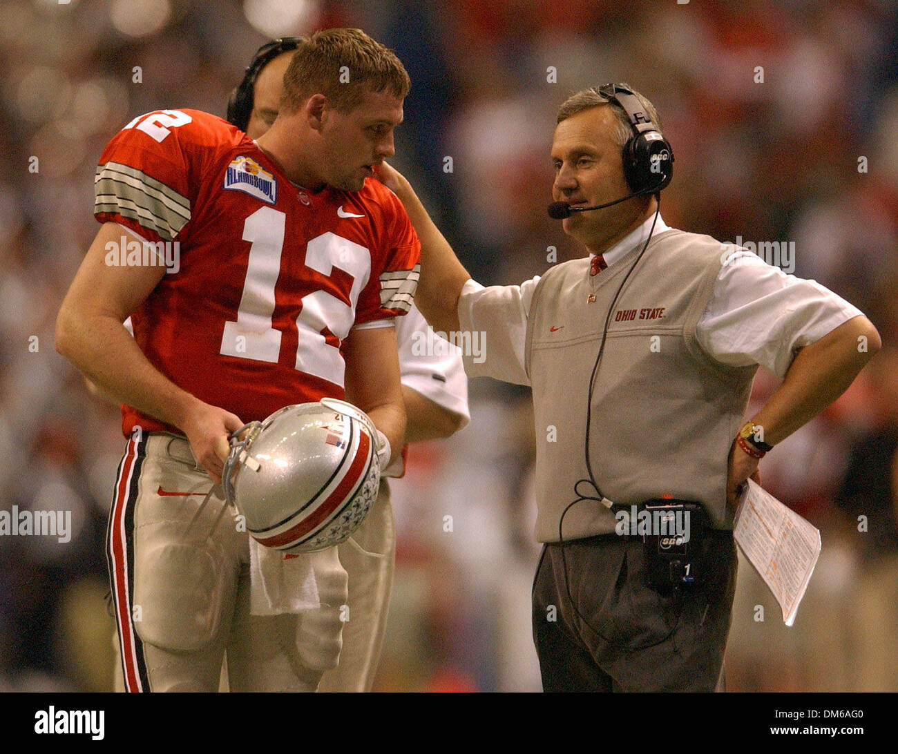 Dec 29, 2004; San Antonio, TX, USA; NCAA Football - Ohio State's head coach Jim Tressel talks with his QB Justin Zwick (12) during 2004 MasterCard Alamo Bowl at the Alamo dome in San Antonio. - Stock Image