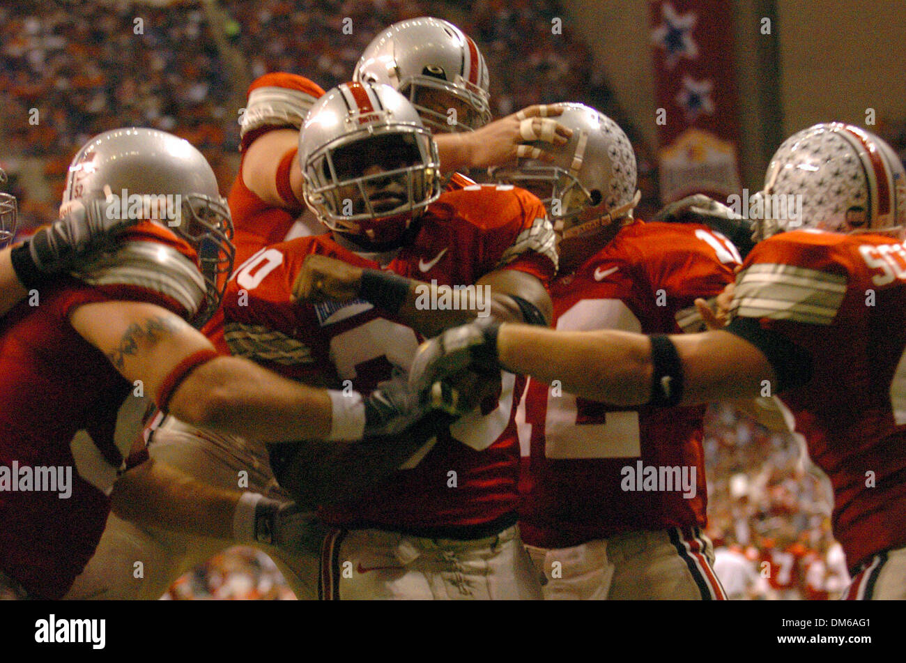 Dec 29, 2004; San Antonio, TX, USA; NCAA Football- Ohio State's Lydell Ross (30) is congratulated after scoring their second touchdown during the 2004 MasterCard Alamo Bowl at the Alamo dome in San Antonio. - Stock Image