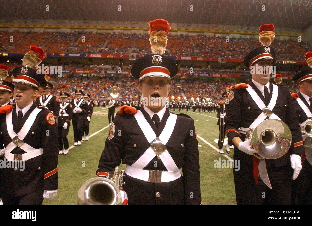 Dec 29, 2004; San Antonio, TX, USA; NCAA Football - Ohio State's band members sings their fight song with the other band members before the start of the 2004 MasterCard Alamo Bowl at the Alamo dome in San Antonio. - Stock Image